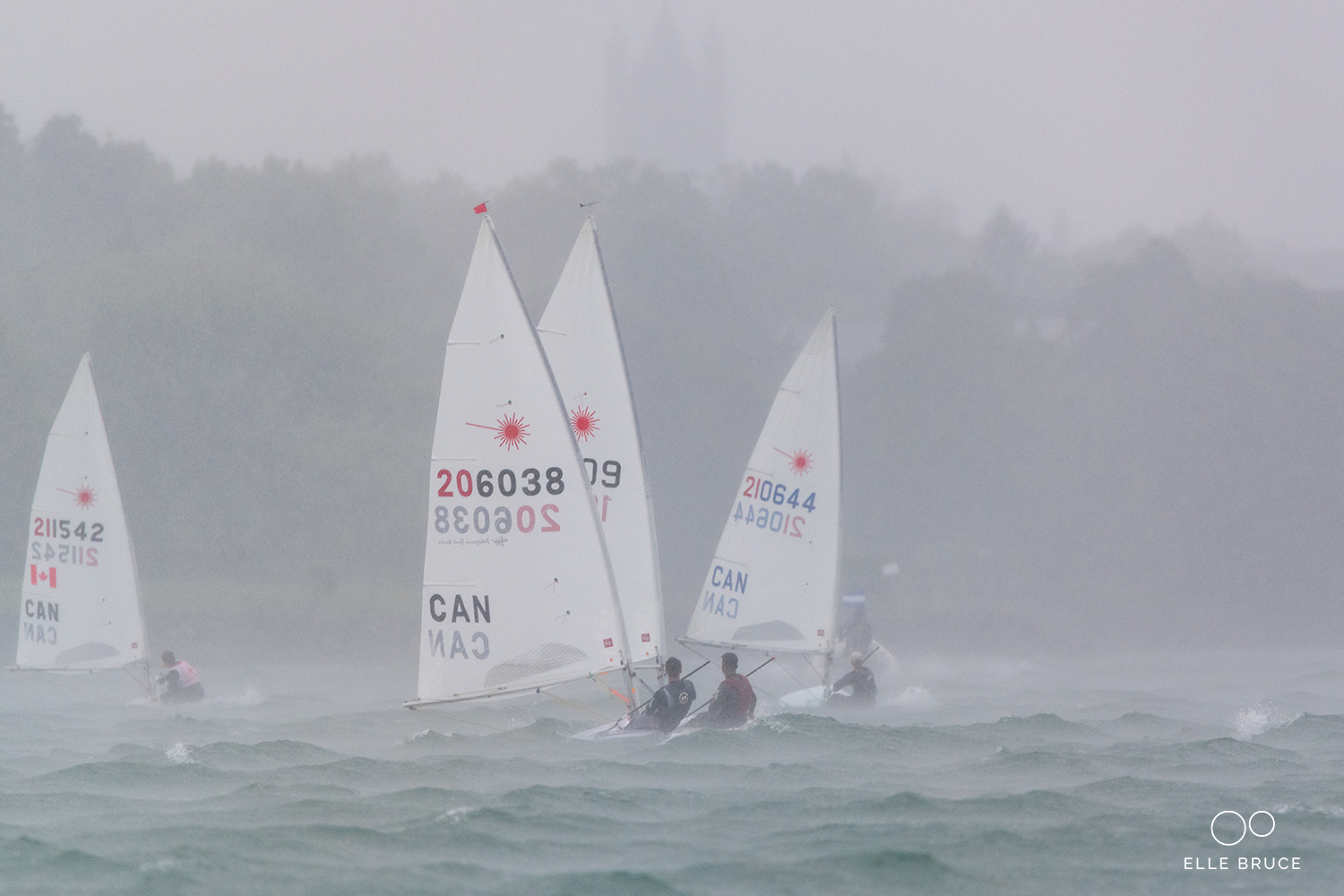 A line squall came through on the final day and when the visibility dropped the Race Committee sent us in. It was a quick if wet reach back to the harbour.  (#206038)