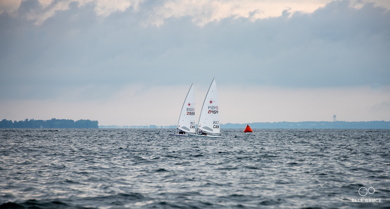 Keeping good company upwind. Just to leeward of me in this shot is fellow Canadian Sailing Development Squad teammate and winner of the regatta Luke Ruitenberg (214514).
