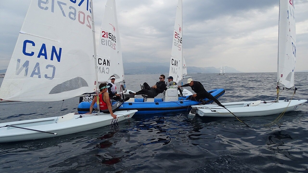 Canadians waiting for wind. PHOTOS:    ILCA Laser Under 21 Worlds Media