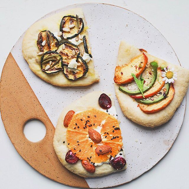 Aaaaand I'm off! Going to Italy for a few weeks, I'll be making some new recipes and sharing some photos from my trip! This is a new ceramic board I made, and it served as a great platter for these flatbreads: zucchini, rosemary + goat cheese, avocado peach, and cherry orange almond.  Hope everyone has a great week 💛