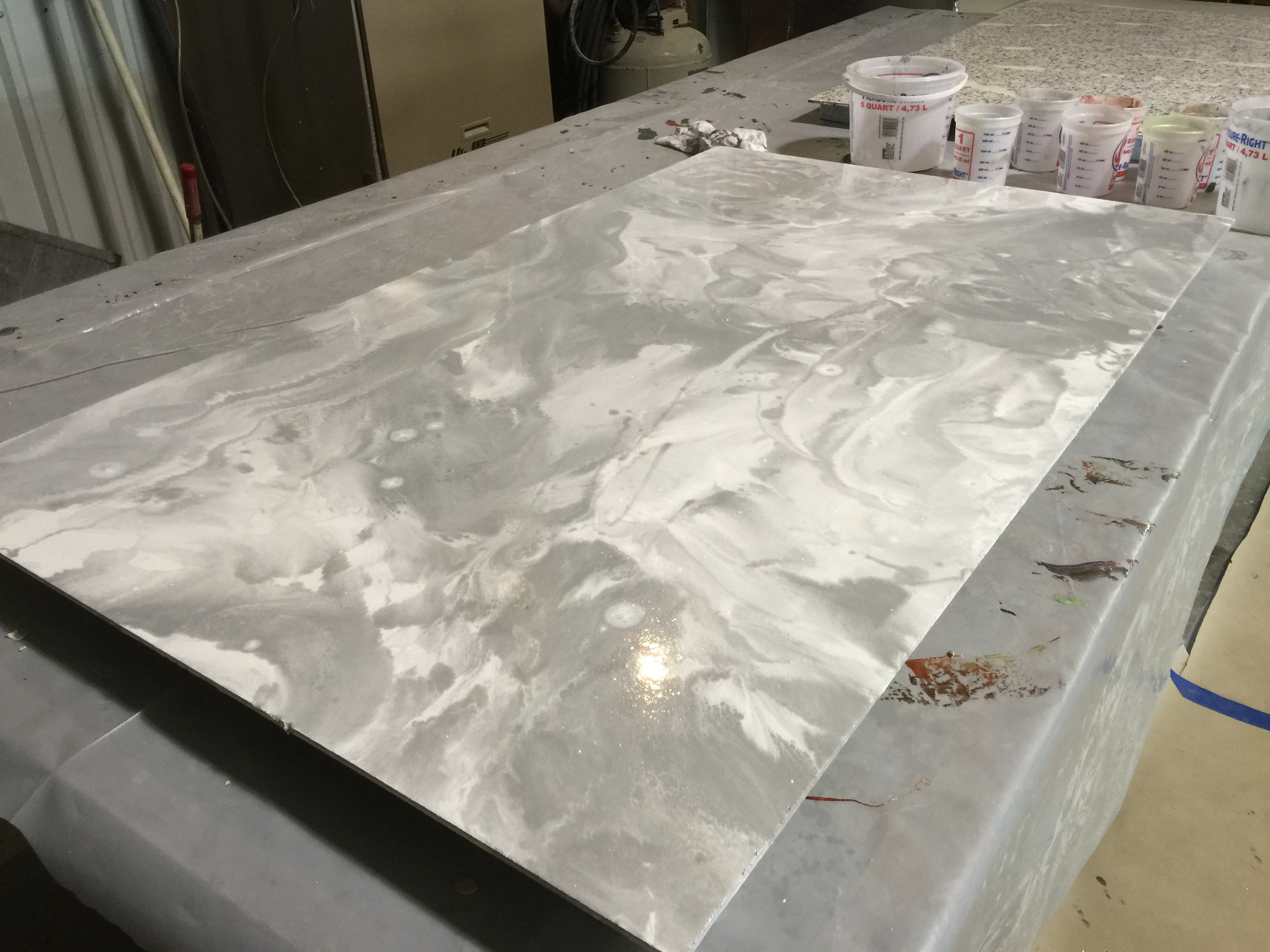Epoxy overlays are made up of COMPONENTS that lock tightly onto the existing concrete or sub-floor. Epoxies are highly durable and popular in garage and warehouse applications although they are gaining APPRECIATION as a basement or main floor covering by contractors nationwide.