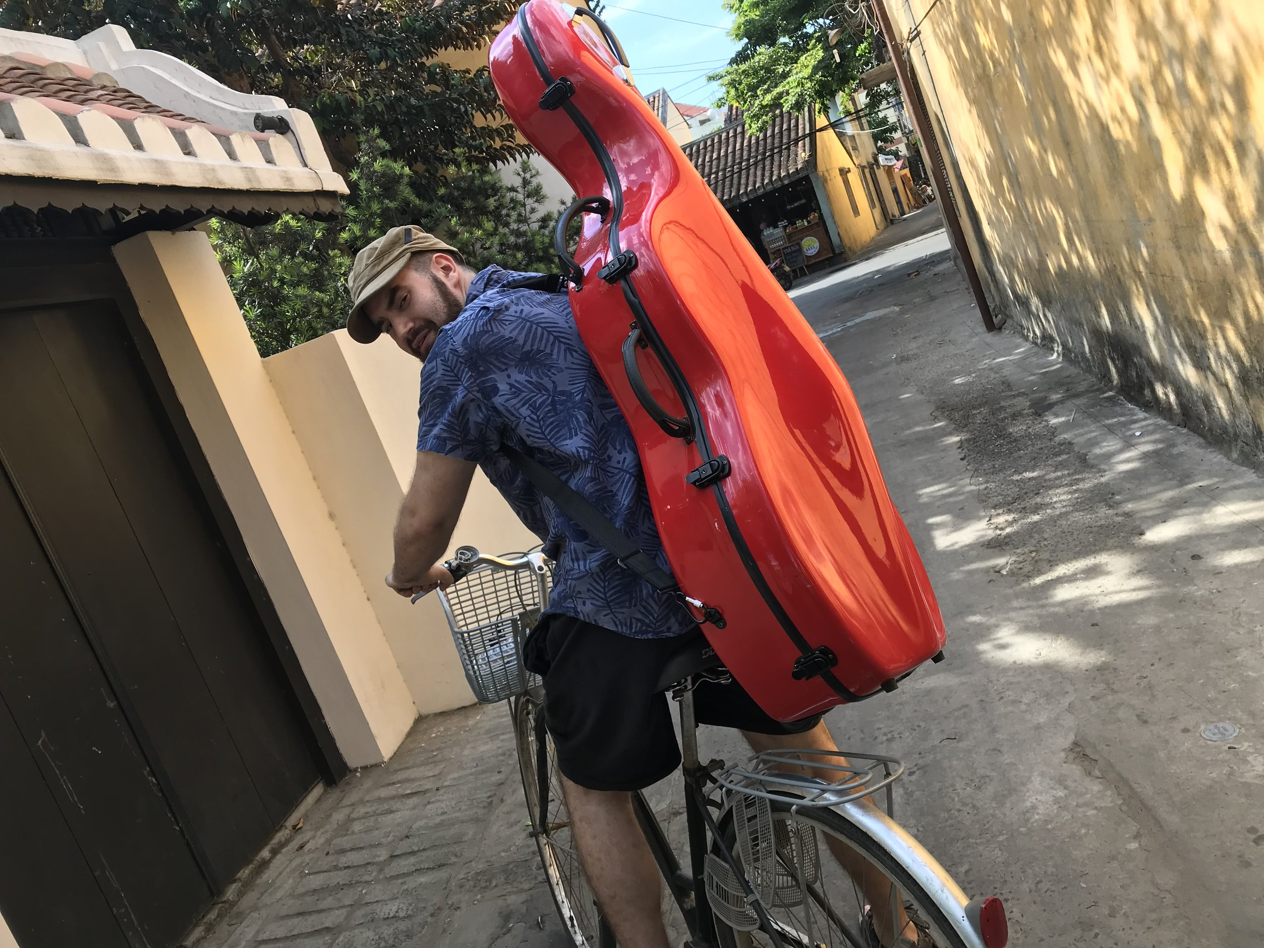 I couldn't believe it myself, but I'm actually able to ride the bike with the cello on my back. I have fully assimilated into Vietnamese culture.