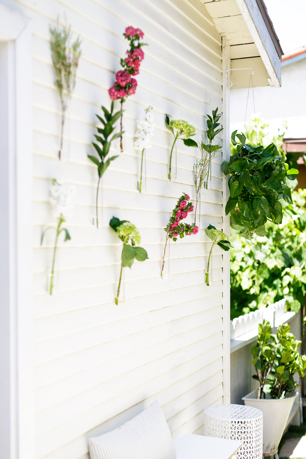 We used  beaker vases from cb2  (paired with farmers market clippings)to liven up the blank exterior walls at a minimal cost.