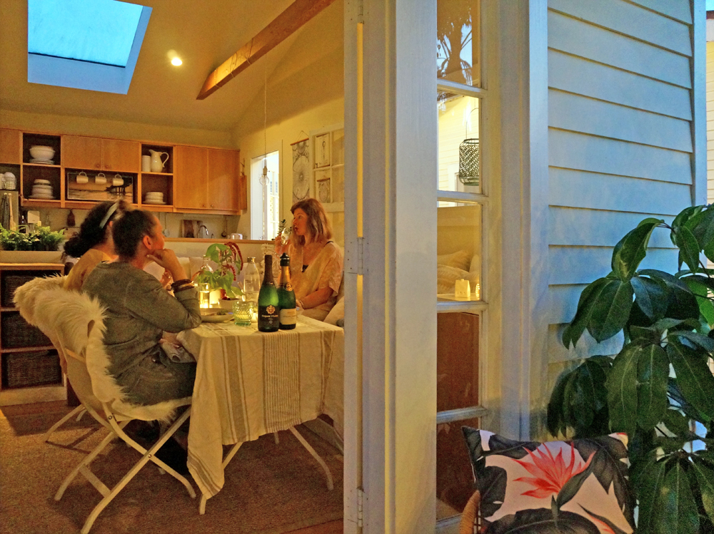 Above:  Justina Blakeney  of  The Jungalow ,  Erica Reitman , and  Jennifer Harrison  of  Flea Market Fab  having dinner at the Cottage.