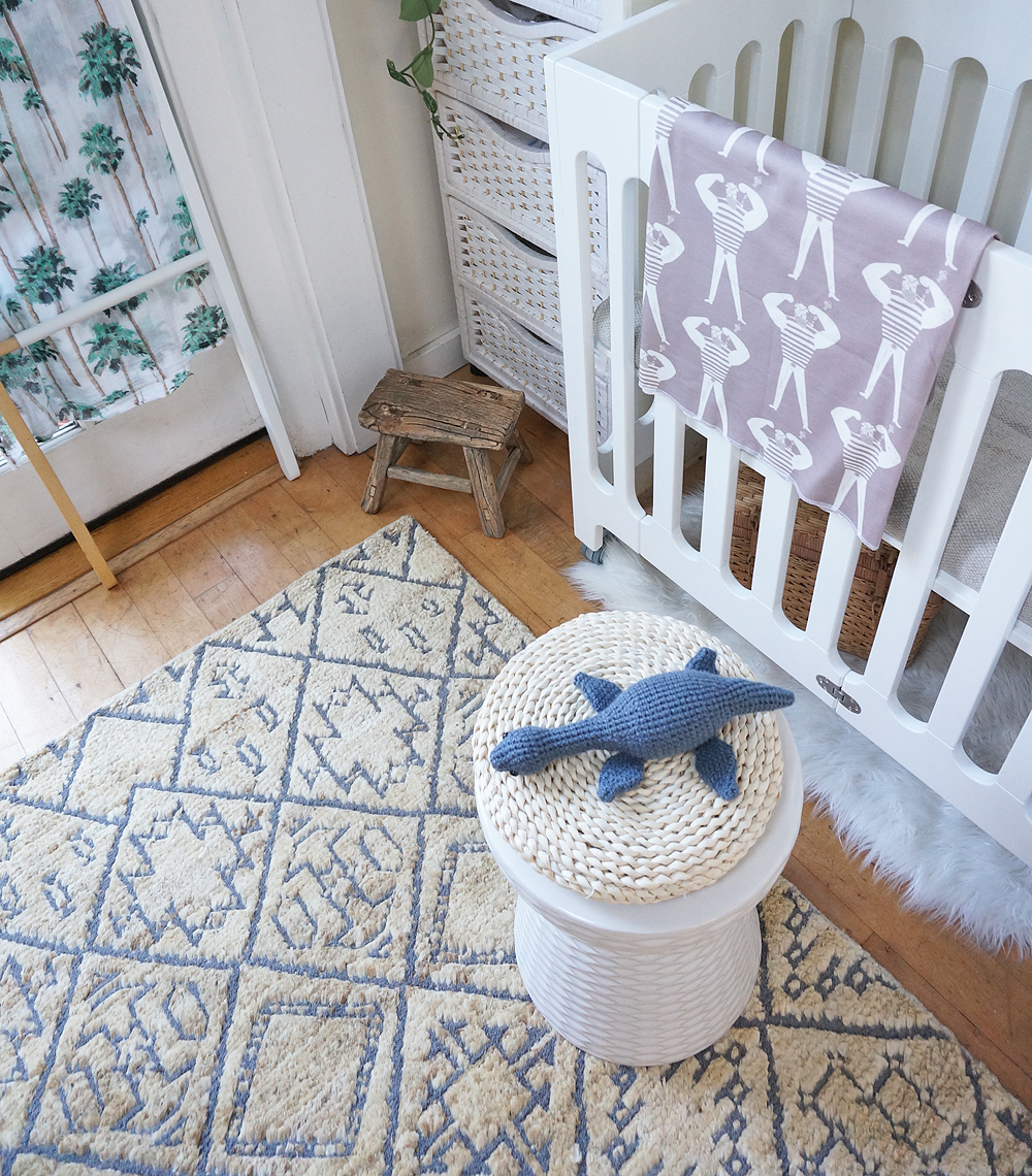 (Also pictured: Handmade Loch Ness monster plush toy  by MEVVSAN  from etsy // Small wooden stool (vintage) // Daphne white garden stool from  home decorators collection  // Sailor swaddle by  Woolf with me )