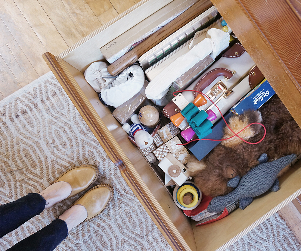 the large Built-in trundle storage bin beneath our bed