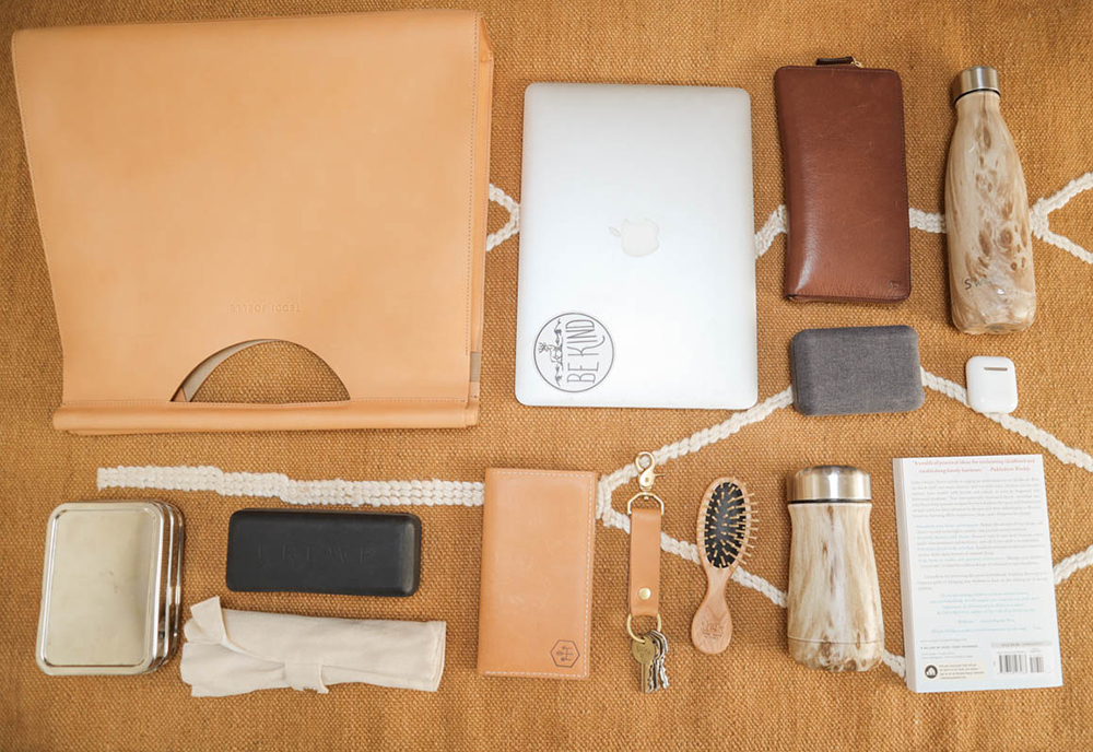 My handbag necessities for home or travel, including a  Nimble wireless charging kit  (made from a sustainable blend of recycled water bottles & organic hemp), bamboo cutlery, reusable bottles, stainless steel to-go food containers, and more.