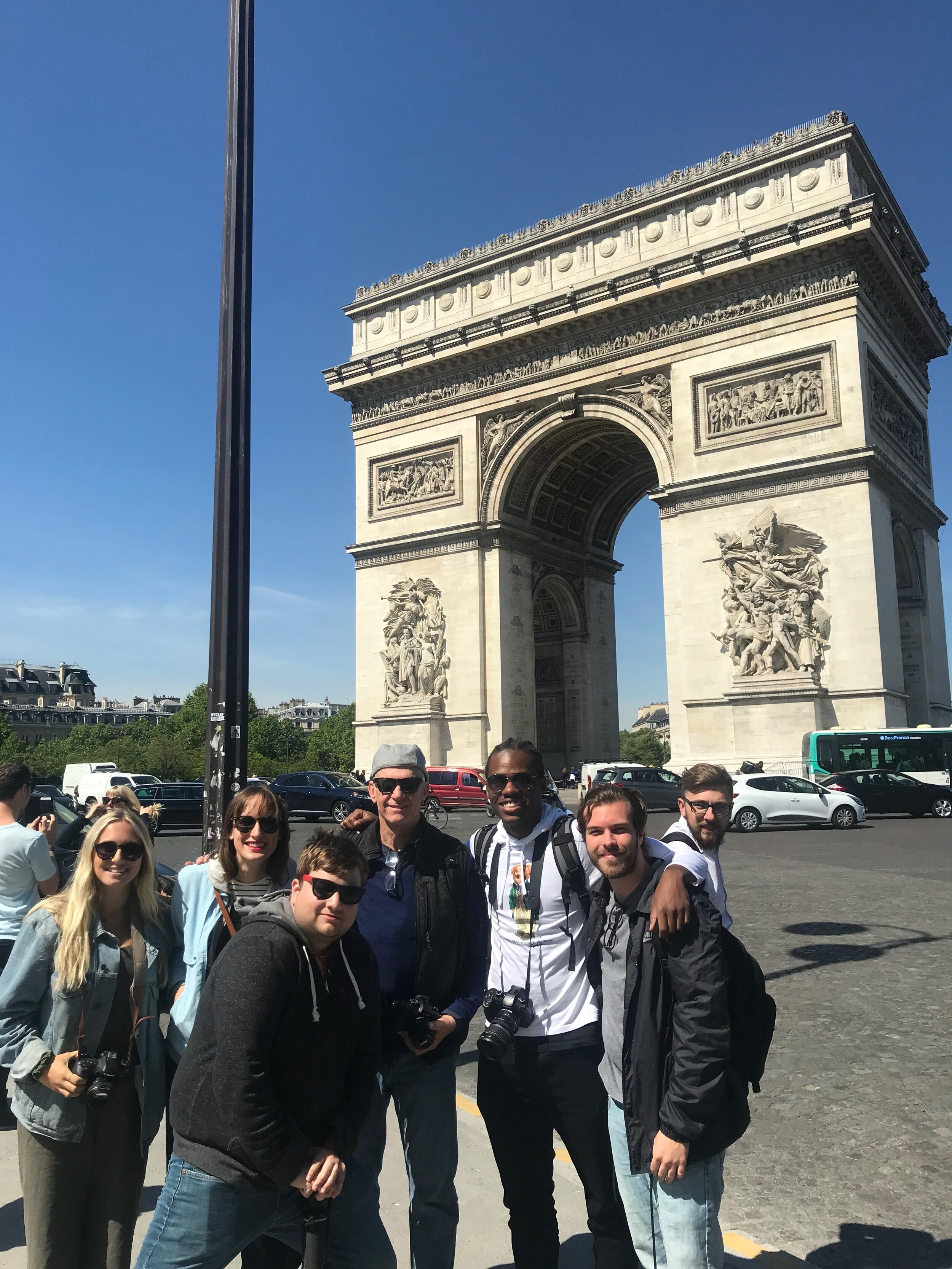 The COM Media gang poses for a photo in front of the Arc de Triomphe.