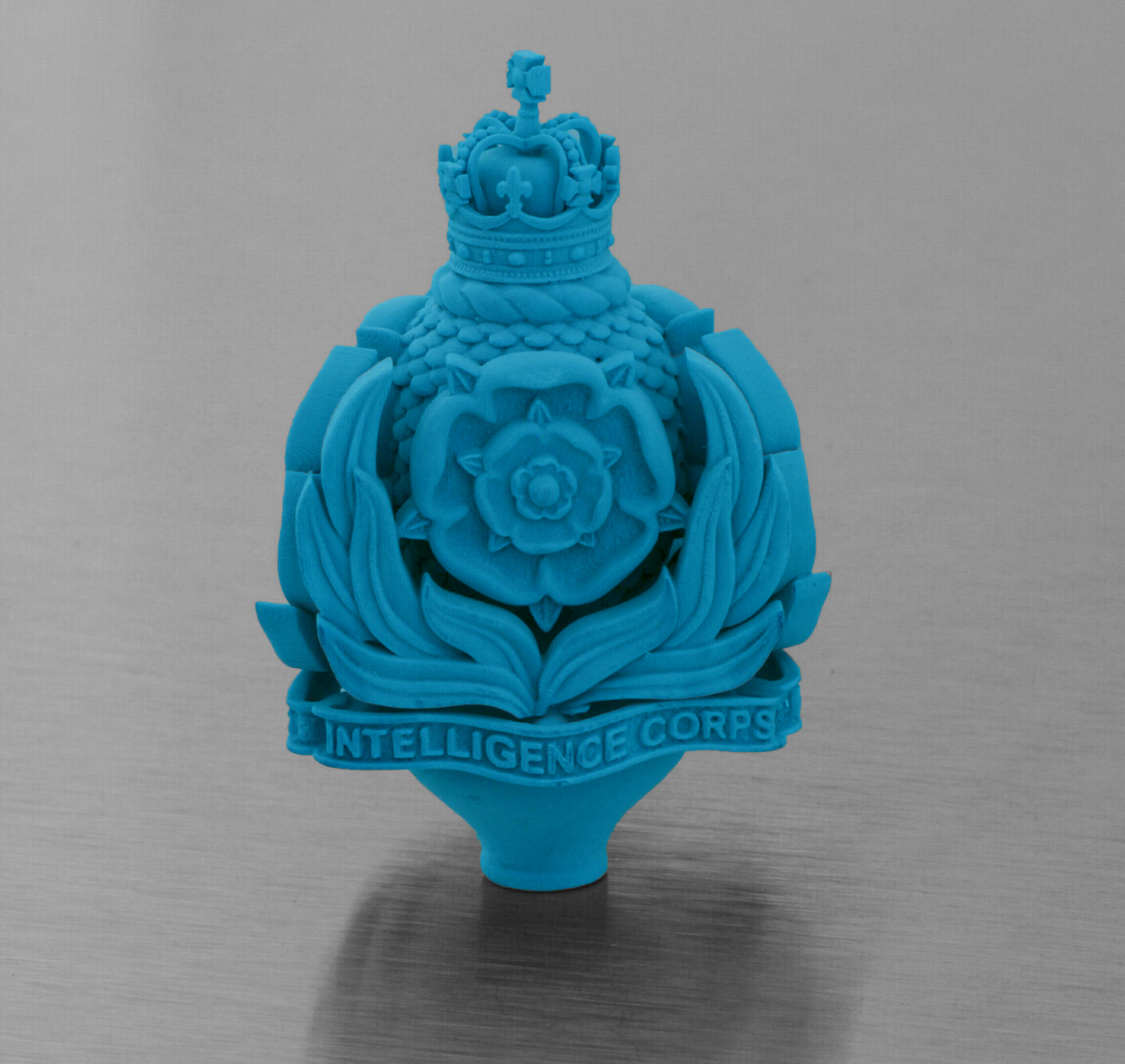 A finial for the Intelligence Corps, later cast into Silver.