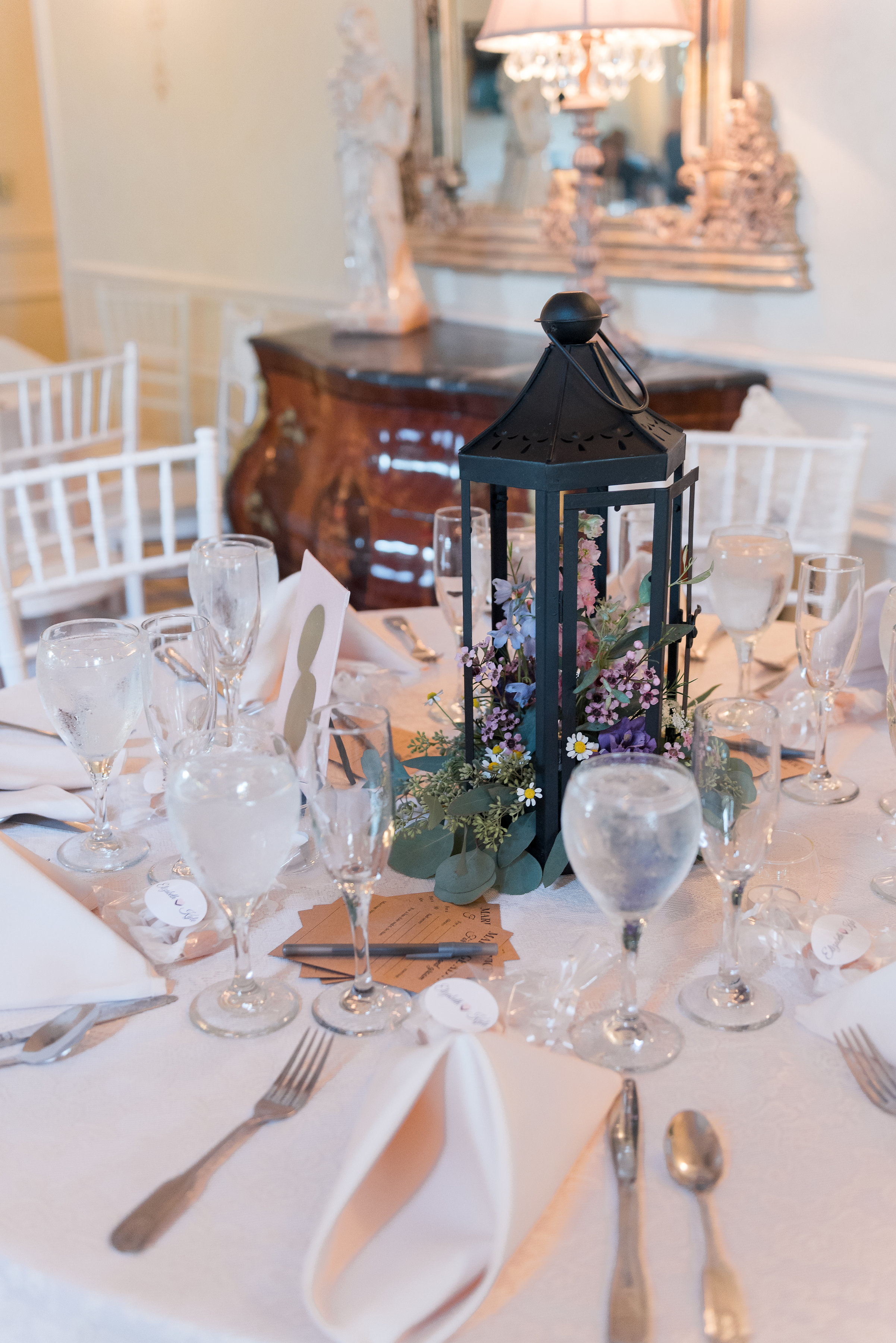Black Lantern - This new spin to the lantern is all about the gushing florals spilling on to the table for a garden feel wedding.