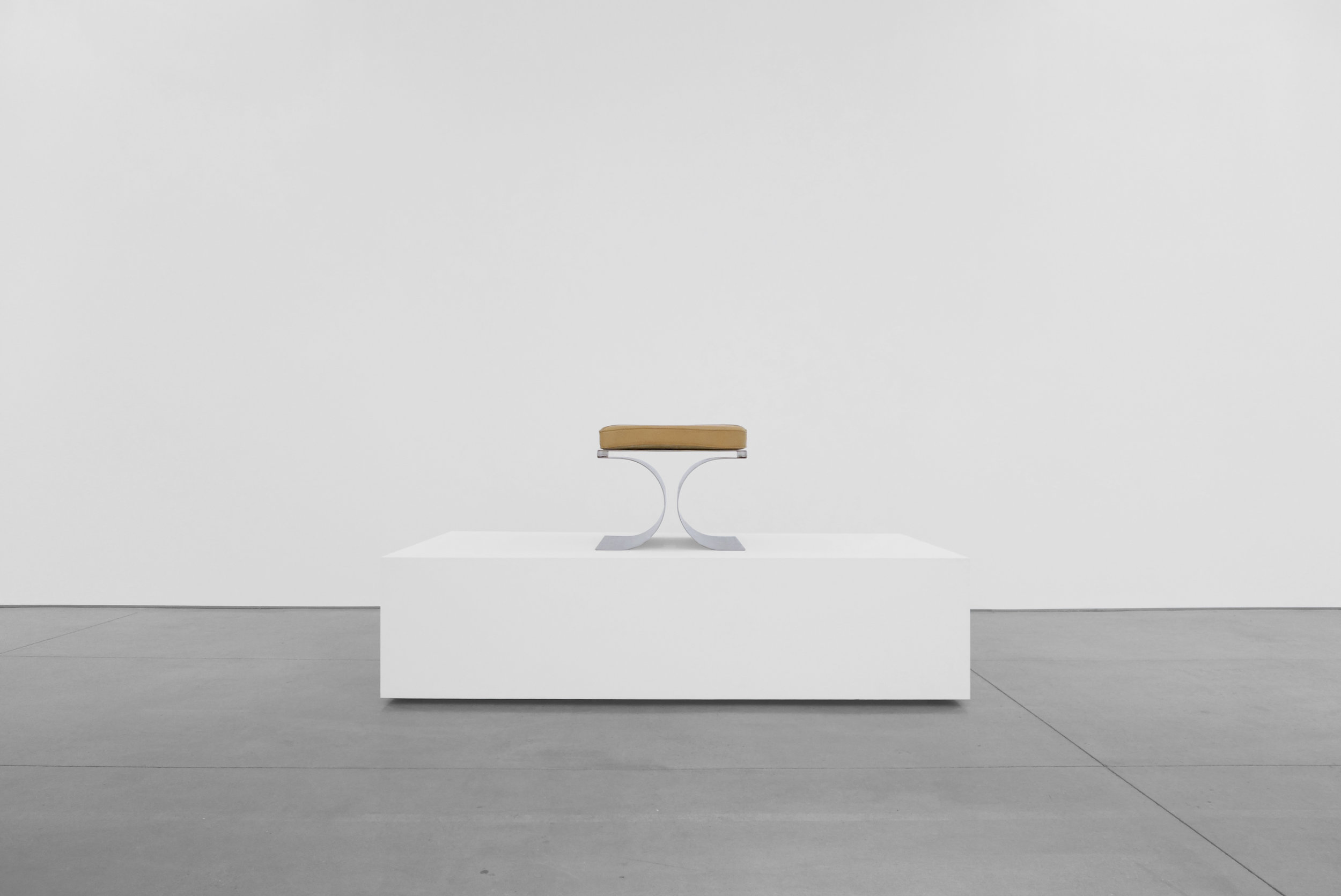 3. Micel Boyer, 'X' Stool, c. 1968, stainless steel and leather upholstery, 16H x 19.75W x 19.75D inches.jpg