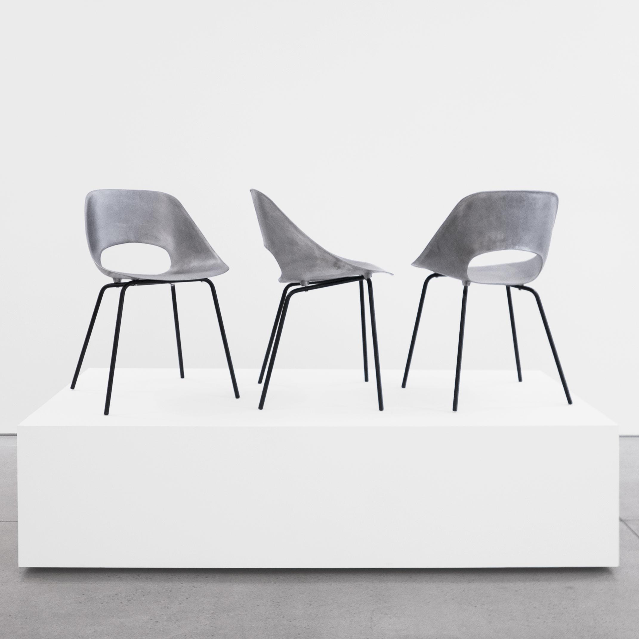 pierre guariche  set of three 'tonneau' cast aluminum chairs  c. 1950 - 1959 ...