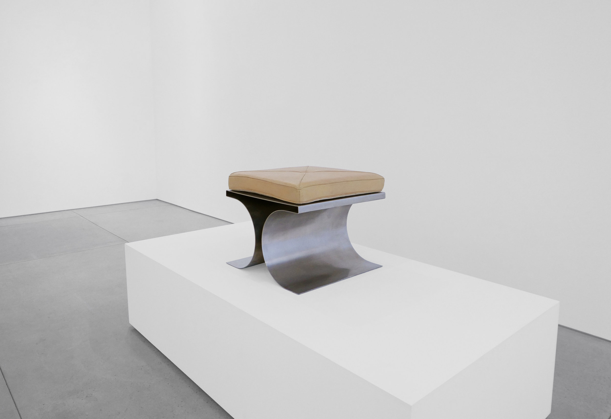 2. Micel Boyer, 'X' Stool, c. 1968, stainless steel and leather upholstery, 16H x 19.75W x 19.75D inches.jpg