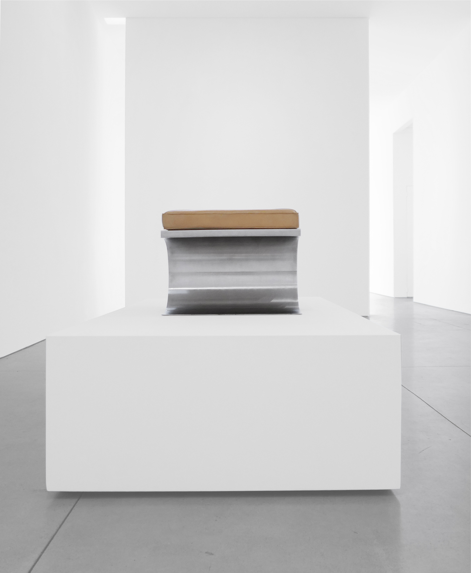 5. Micel Boyer, 'X' Stool, c. 1968, stainless steel and leather upholstery, 16H x 19.75W x 19.75D inches.jpg