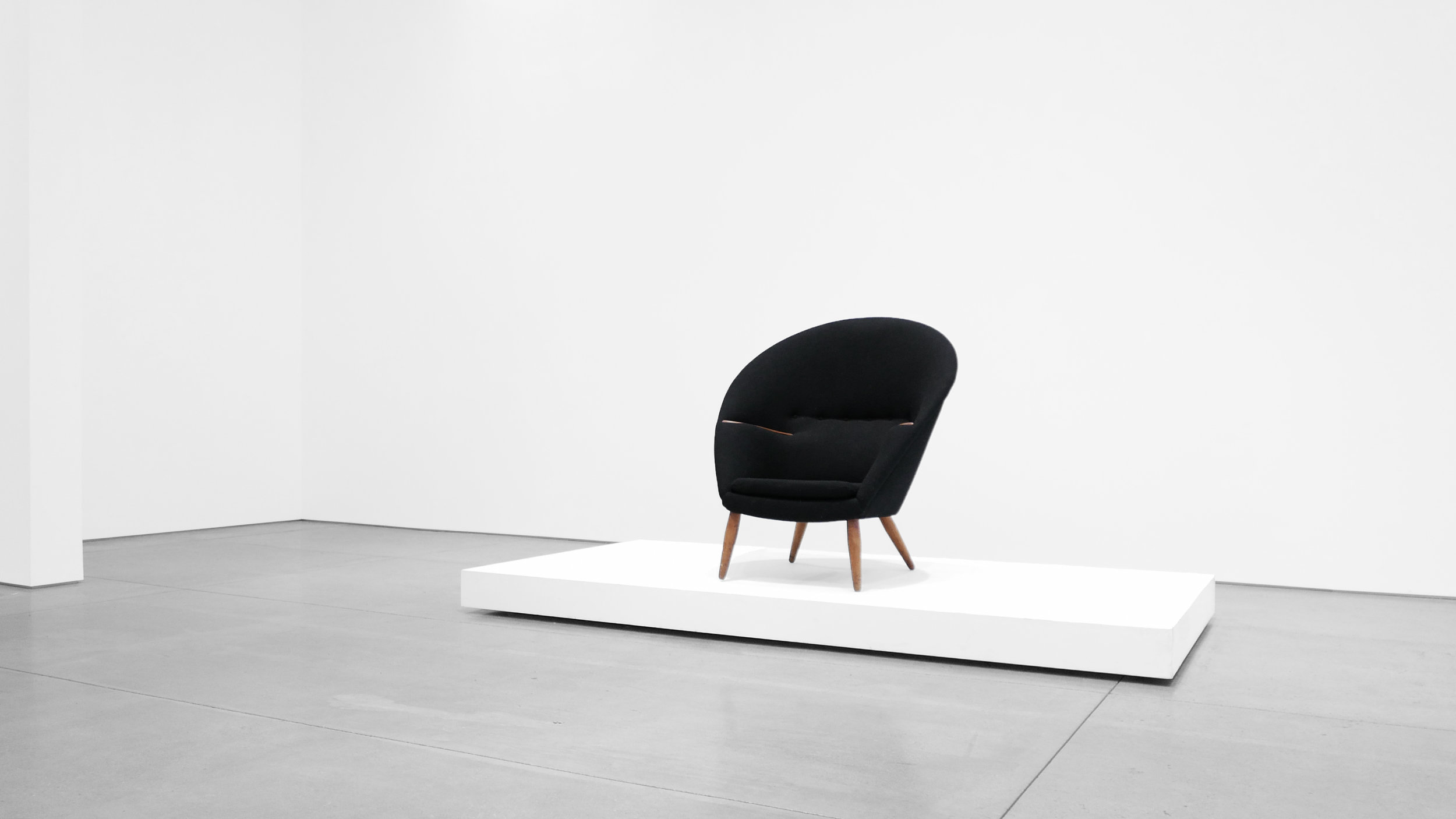 2. Nanna Ditzel, Lounge Chair, 1953, Upholstery, stained oak, teak, 38H × 35W × 34D inches.jpg