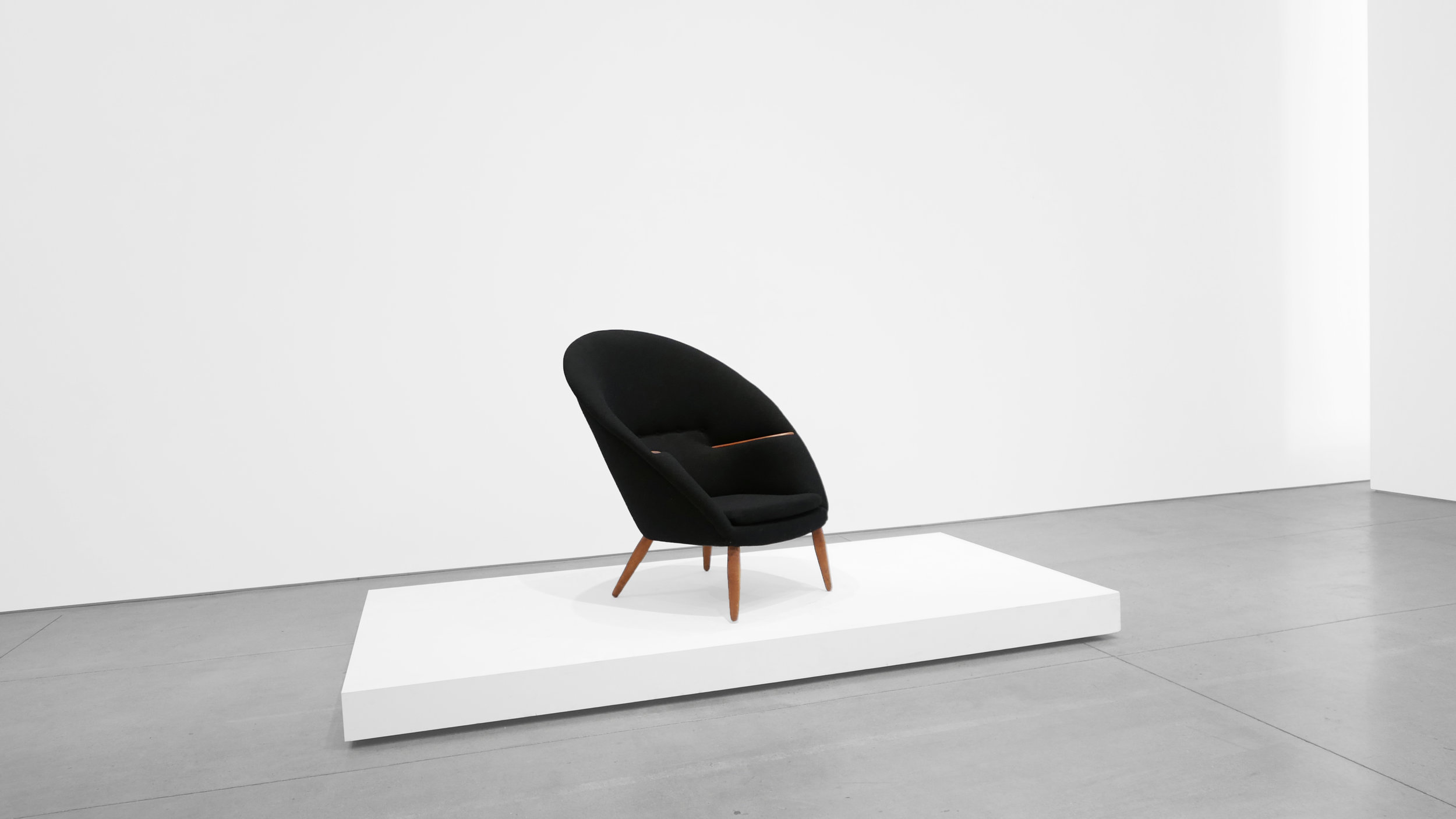 4. Nanna Ditzel, Lounge Chair, 1953, Upholstery, stained oak, teak, 38H × 35W × 34D inches.jpg