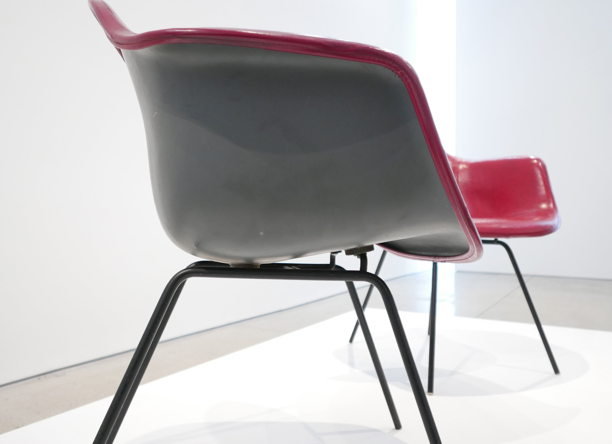 7. Ray and Charles Eames, 'DAX' Chairs, 1954, molded and lacquered fiberglass, vinyl, enameled steel, plastic, 31 x 25.5 x 25 inches.jpg