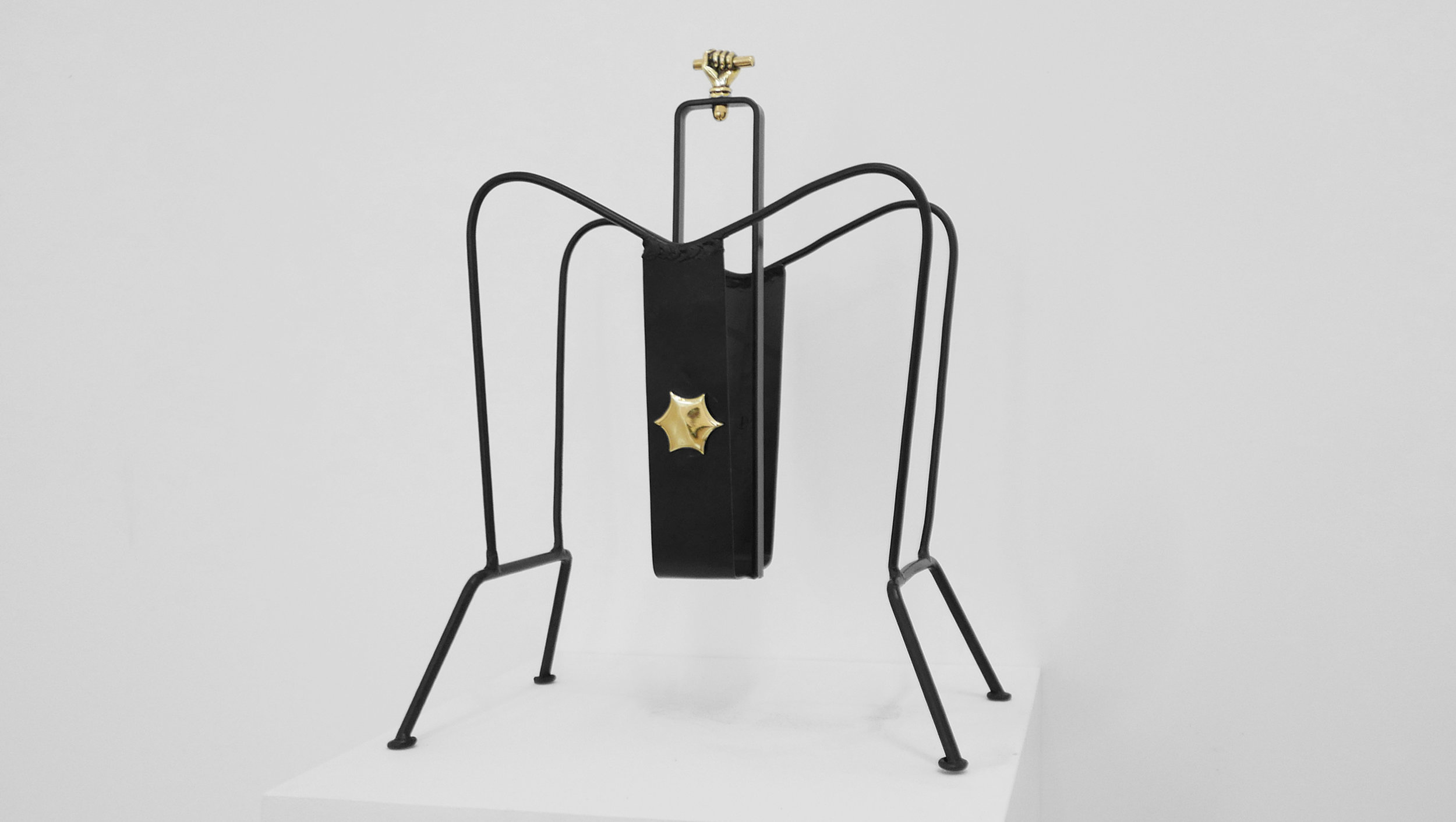 3. Jacques Adnet, 'Magazine Holder,' c. 1950s, black lacquered metal, brass, 18H x 13W x 8D inches.jpg