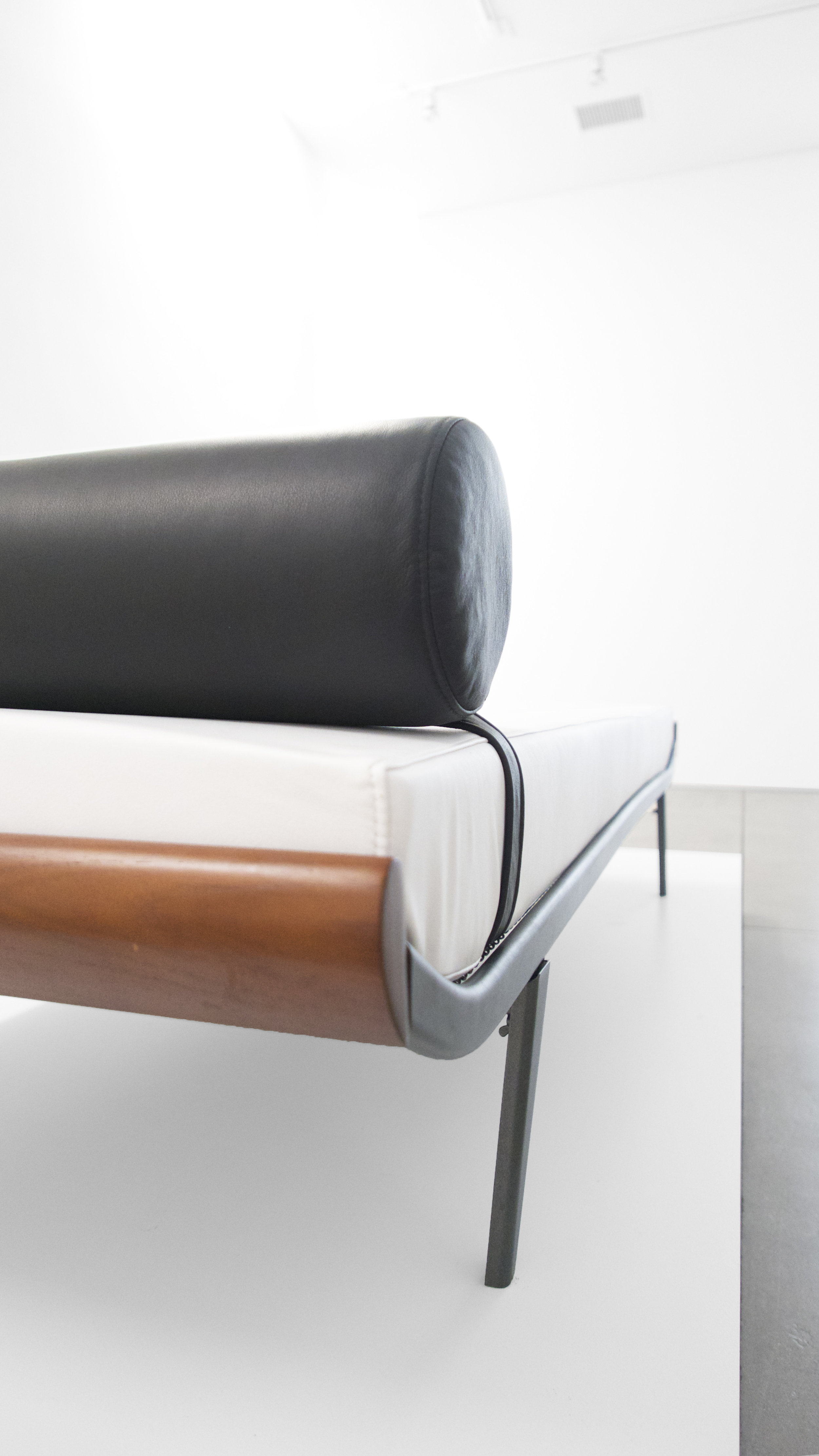 6. A.R. Cordemijer, 'Cleopatra' Daybed for Auping, c. 1960s, leather, teak, powder-coated metal, 23H x 32W x 76.5L inches.jpg