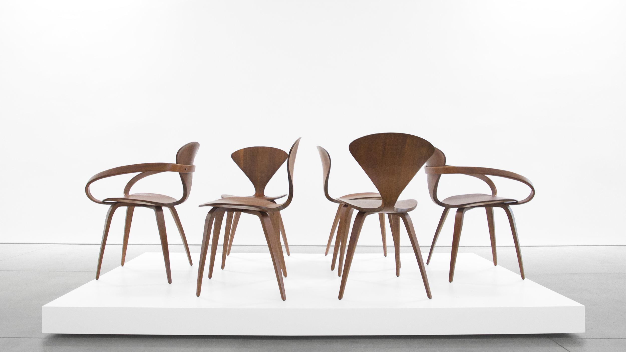 2. Norman Cherner, Pretzel Chairs, c. 1958, walnut, (4) 31H x 17W x 18.5 inches (2) 31H x 26W x 19D inches.jpg