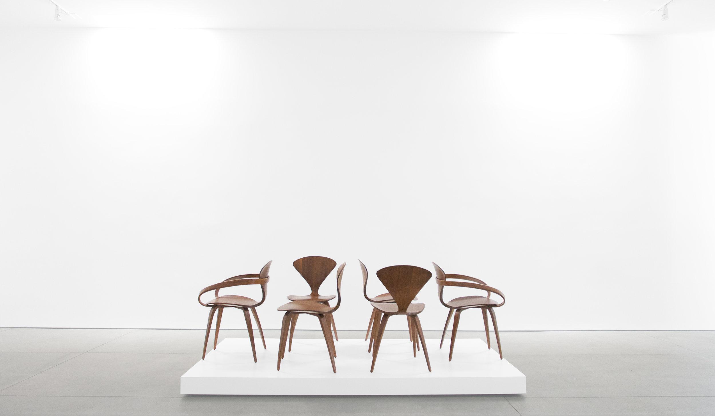 1. Norman Cherner, Pretzel Chairs, c. 1958, walnut, (4) 31H x 17W x 18.5 inches (2) 31H x 26W x 19D inches.jpg