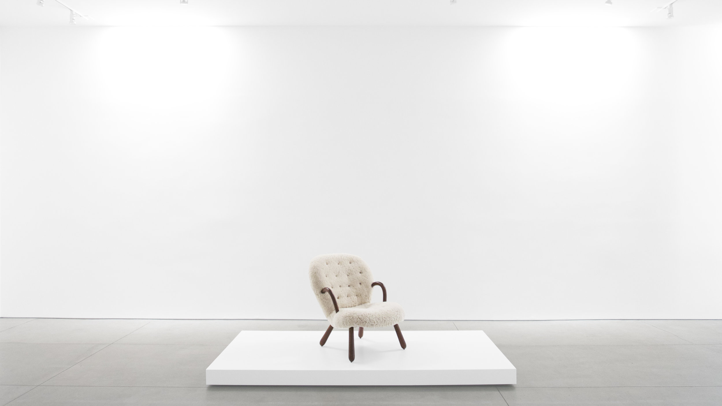 7. Philip Arctander, %22'Clam' Chair,%22 c. 1940s, birchm sheepskin, 32.5H x 26W x 32D inches.jpg