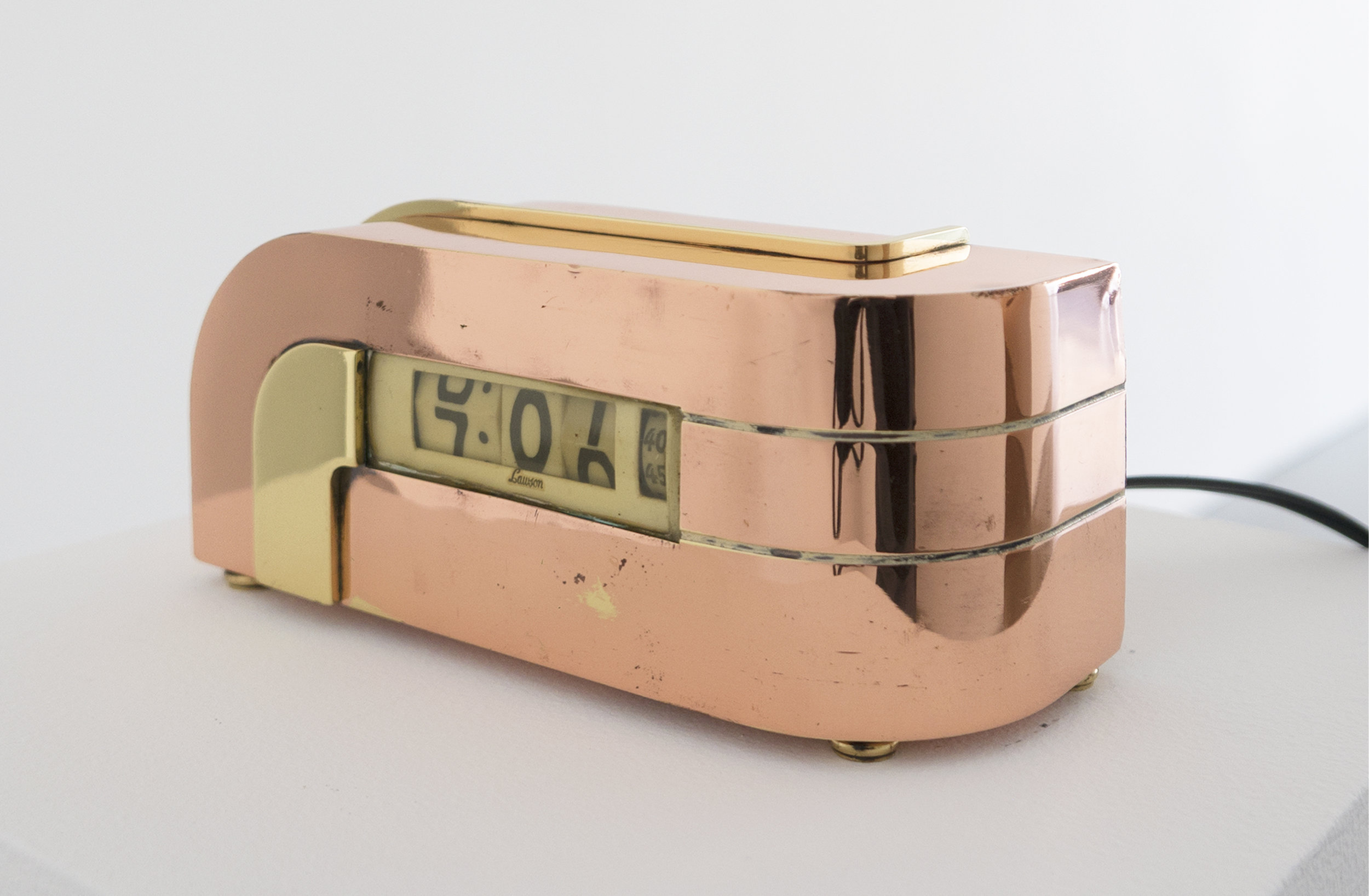 KEM Weber, 'Zephyr' Clock, 1933, 8 x 3.5 x 3.5 inches, Copper, Brass.jpg