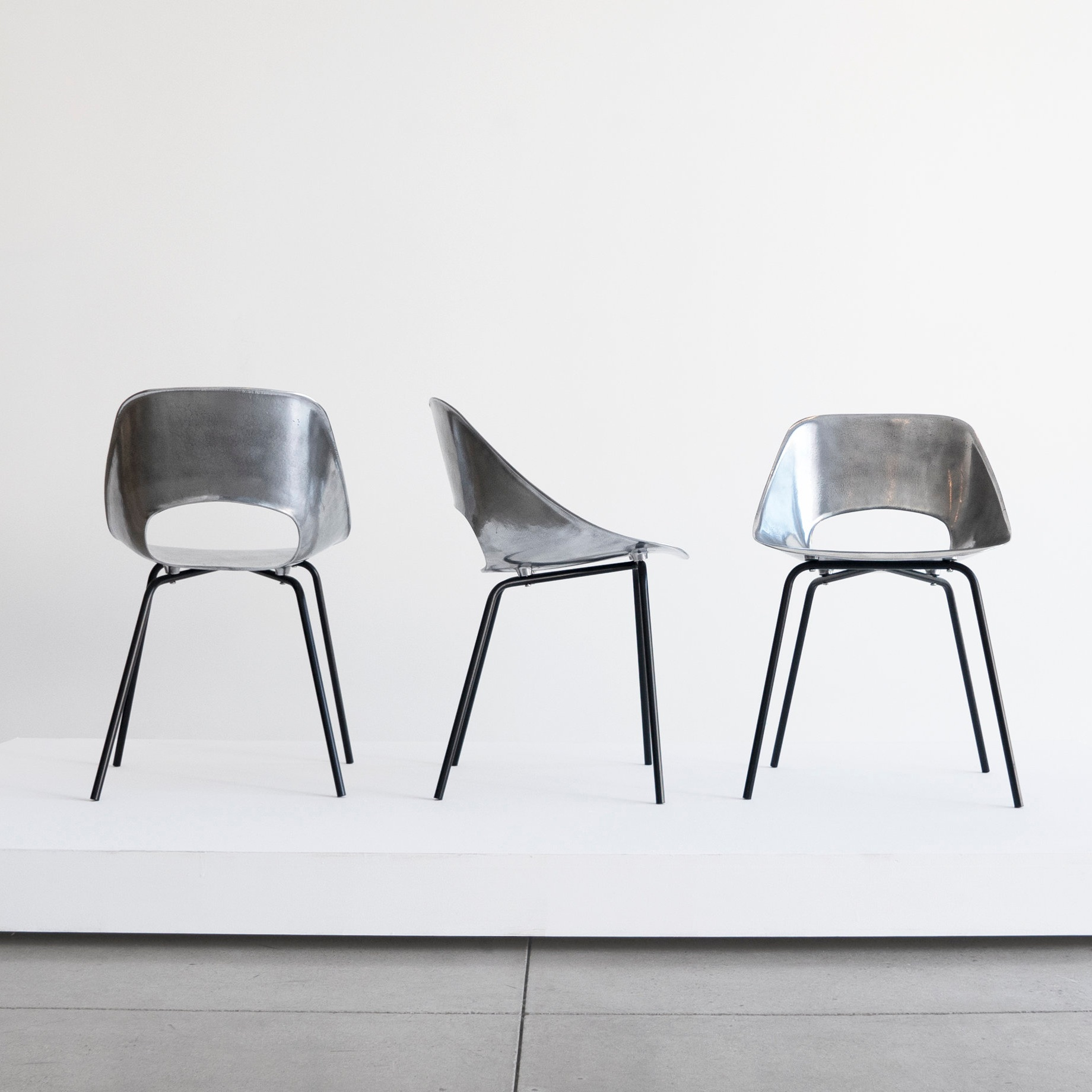 pierre guariche set of three 'tonneau' cast aluminum chairs $12,000