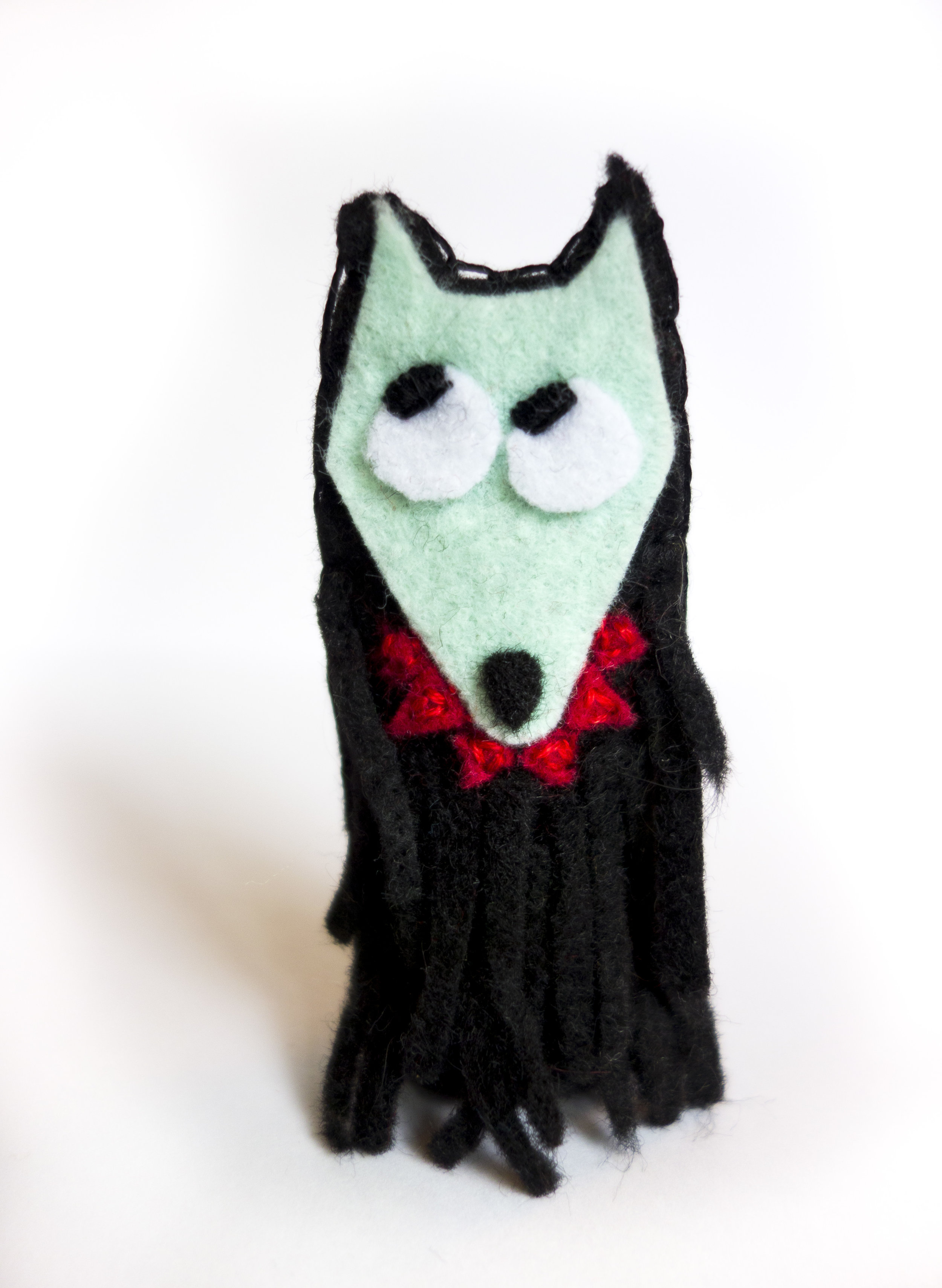 Werewolf - Do they come any cuter? Embroidered eyes, and embroidered over the teeth (I was afraid they'd fall off). To make the fur, I cut a small rectangle of black felt, then cut it into a zillion little matchstick-sized pieces, then glued them on at one end.