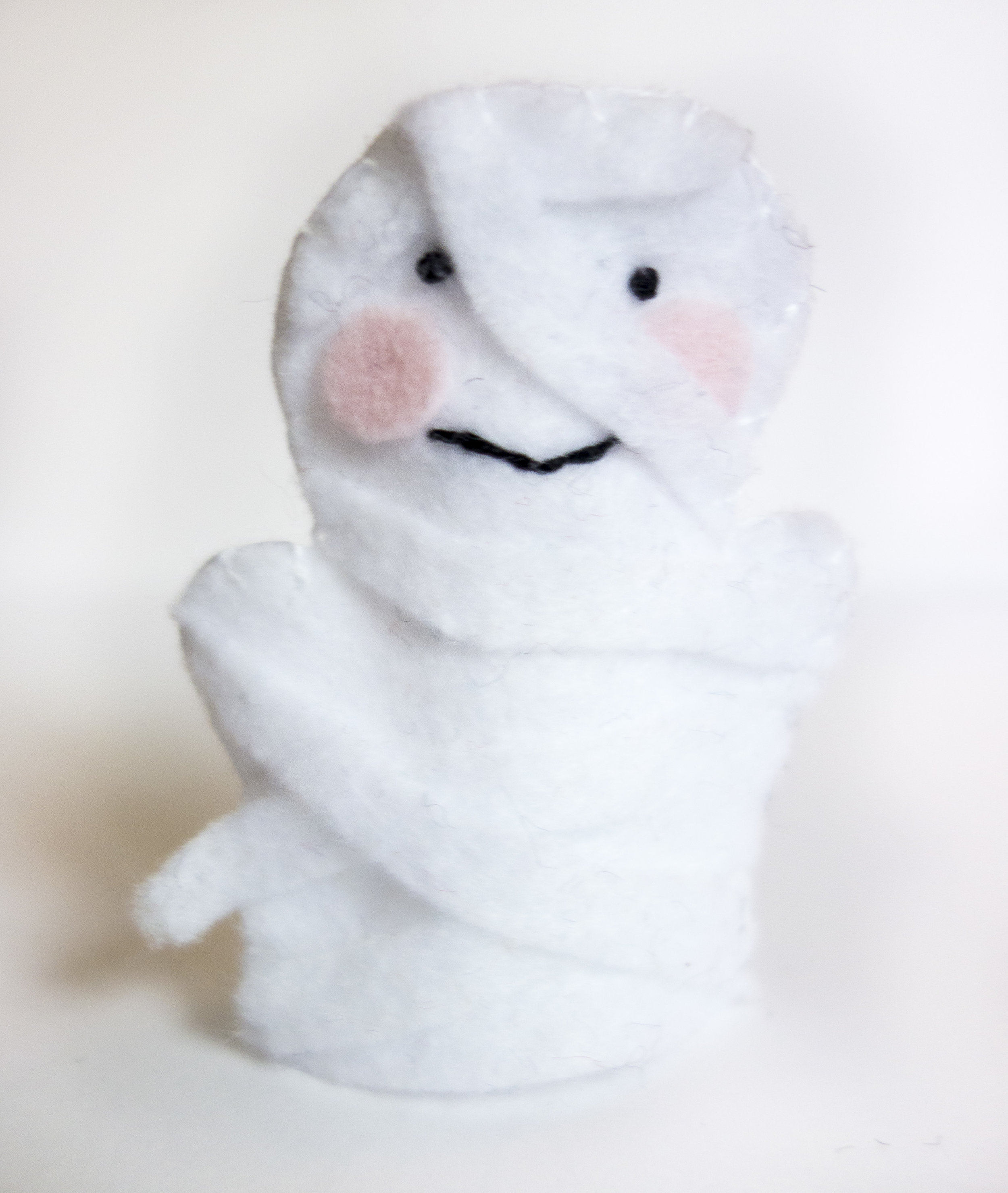 Mummy - After gluing on cheeks and making french knot eyes, I used one long strip of white and trimmed it as I arranged it in overlapping layers.