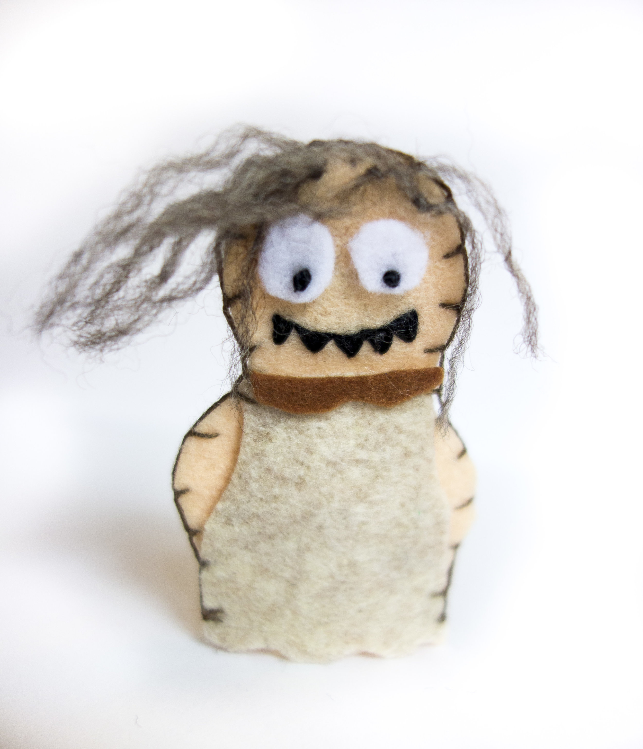 Zombie - This girl turned out adorable. French knot eyes, embroidered fangs, and frayed hair made by separating strands of wool thread.