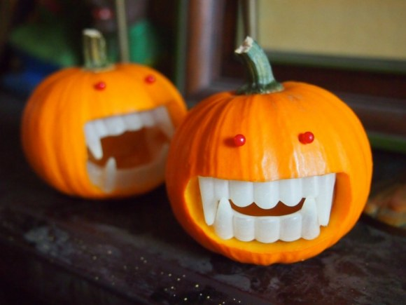 Originally from Martha Steward, I love this idea. Use some glow-in-the-dark fangs for extra creepiness.