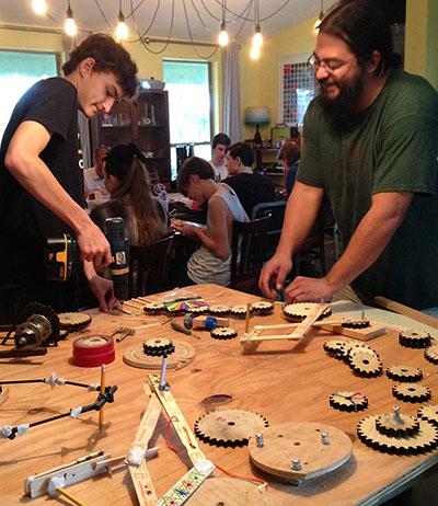 Wyeth and art teacher Johnny Villarreal working on a drawing machine.
