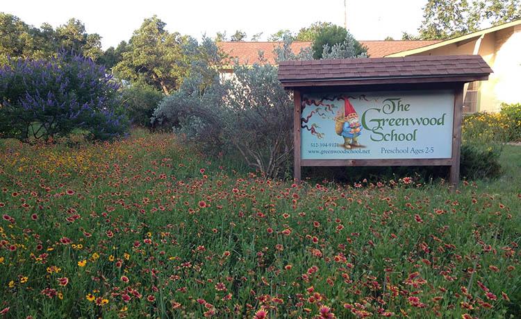 GreenwoodSchool_Sign-with-Wildflowers.jpg
