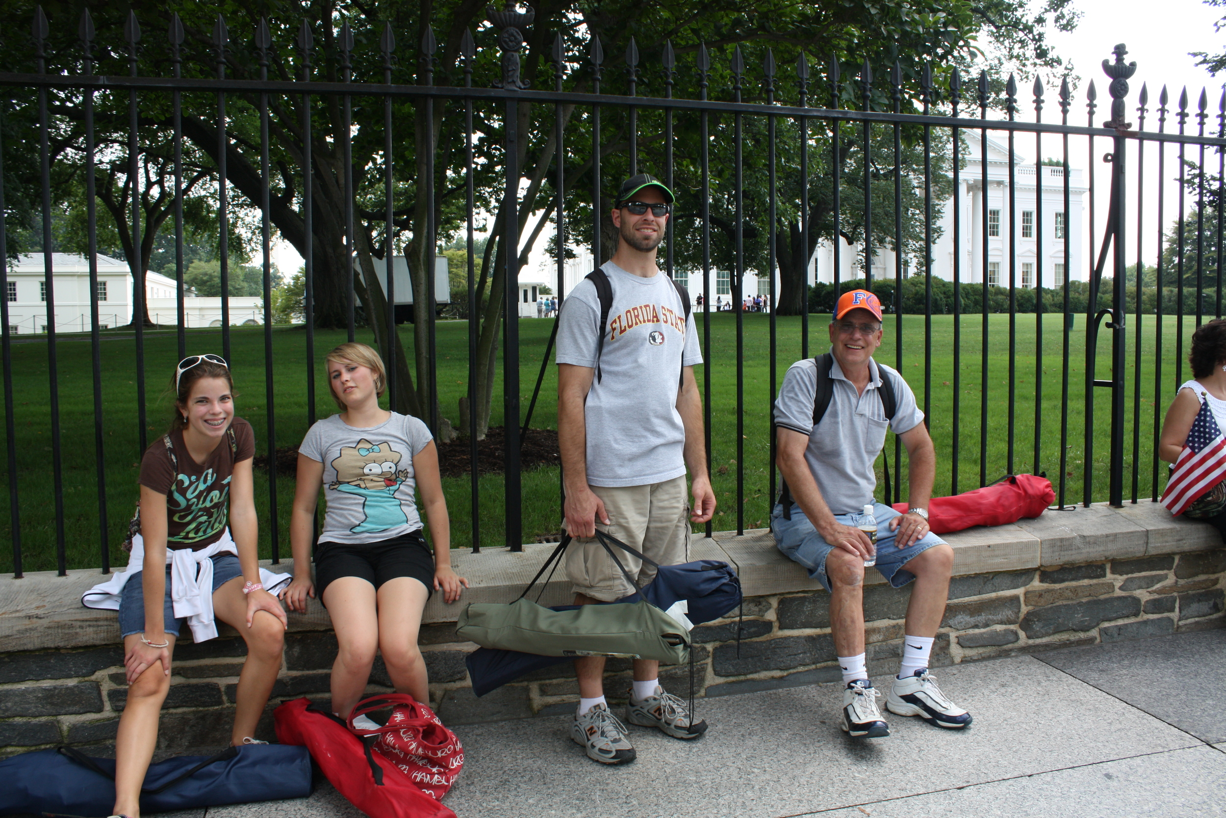 THE TIRED BUNCH WITH THEIR CHAIRS AND BACKPACKS