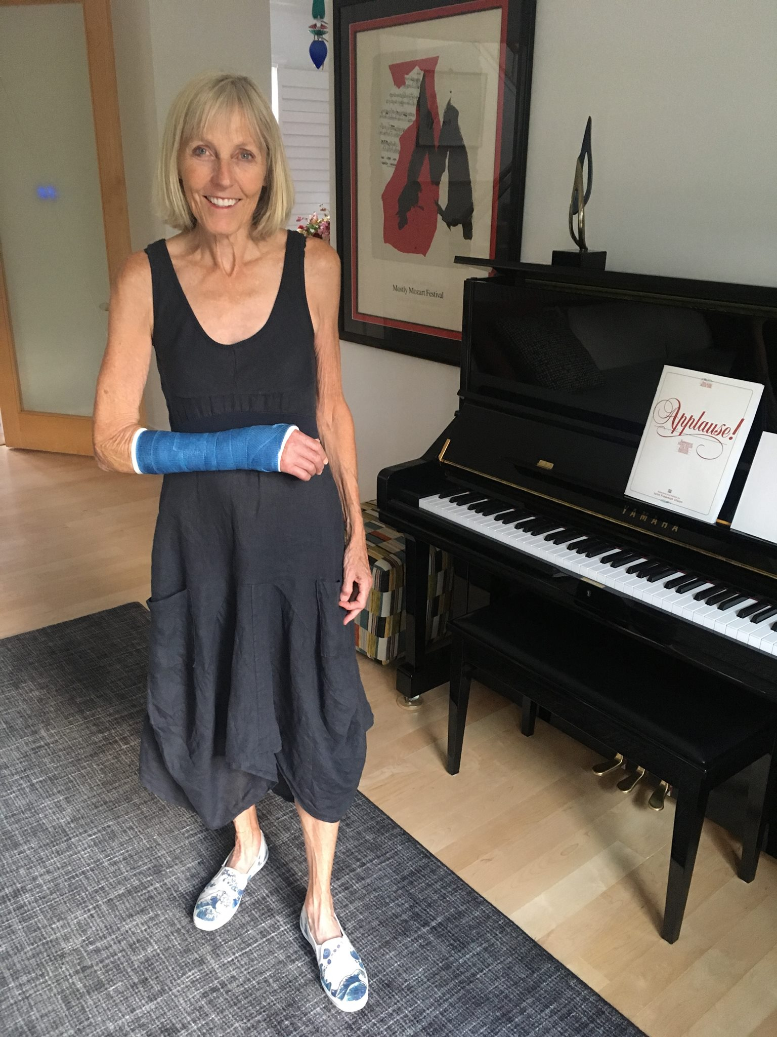 Pat with arm in new blue cast and wearing shoes that Alex created about 10 years ago.