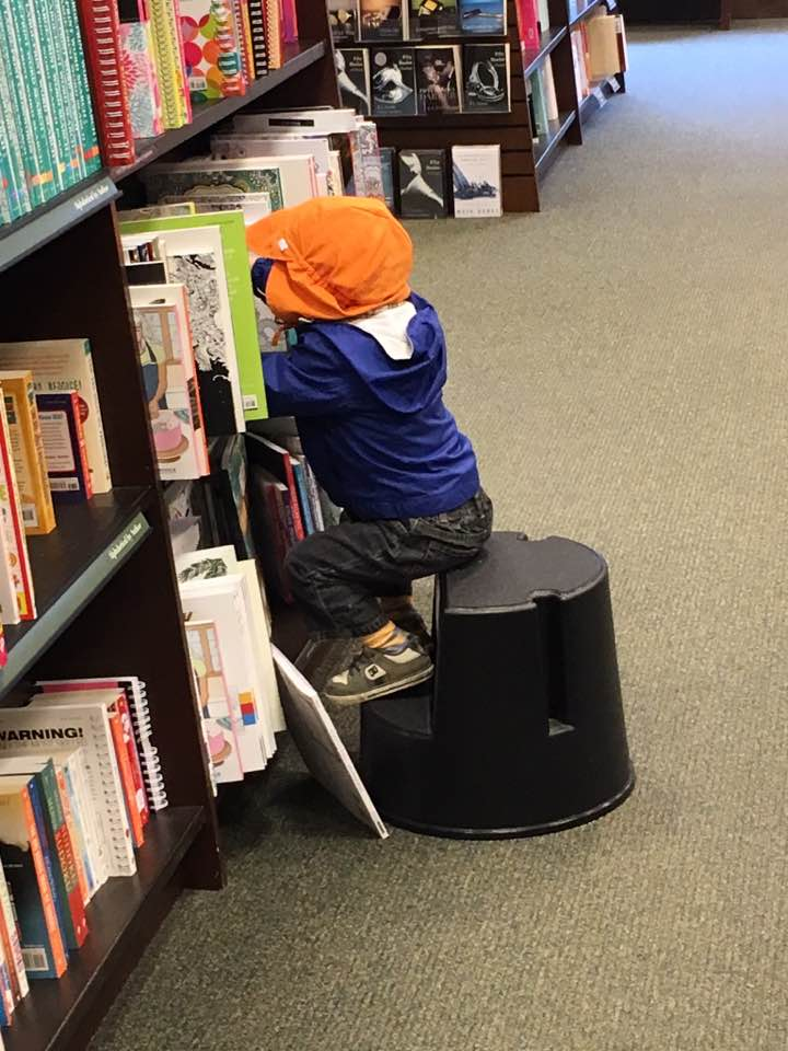 Grandson Solomon at the library, starting young!