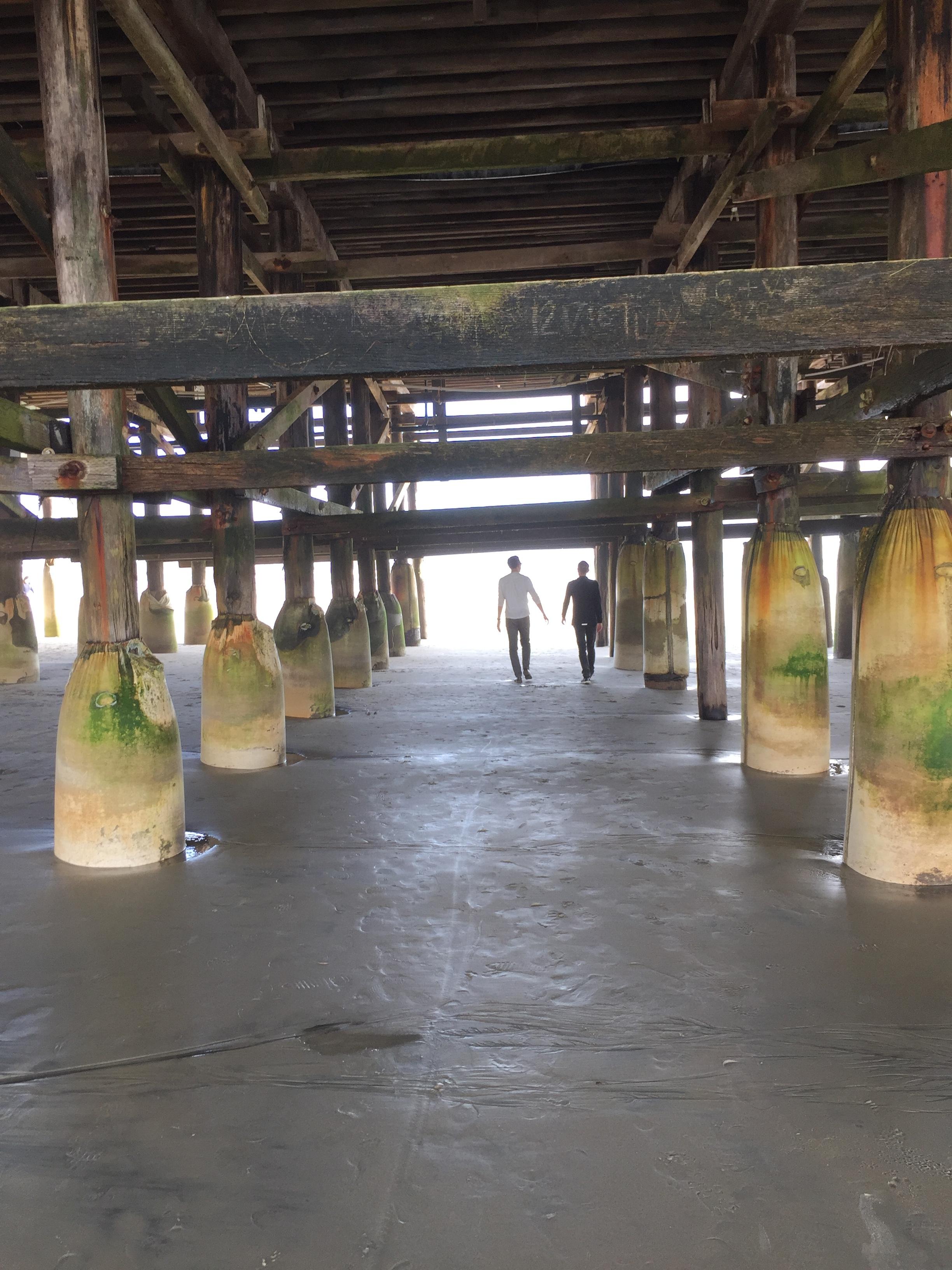 Doug and Alex walking beneath Crystal Pier near Pacific Beach, San Diego.