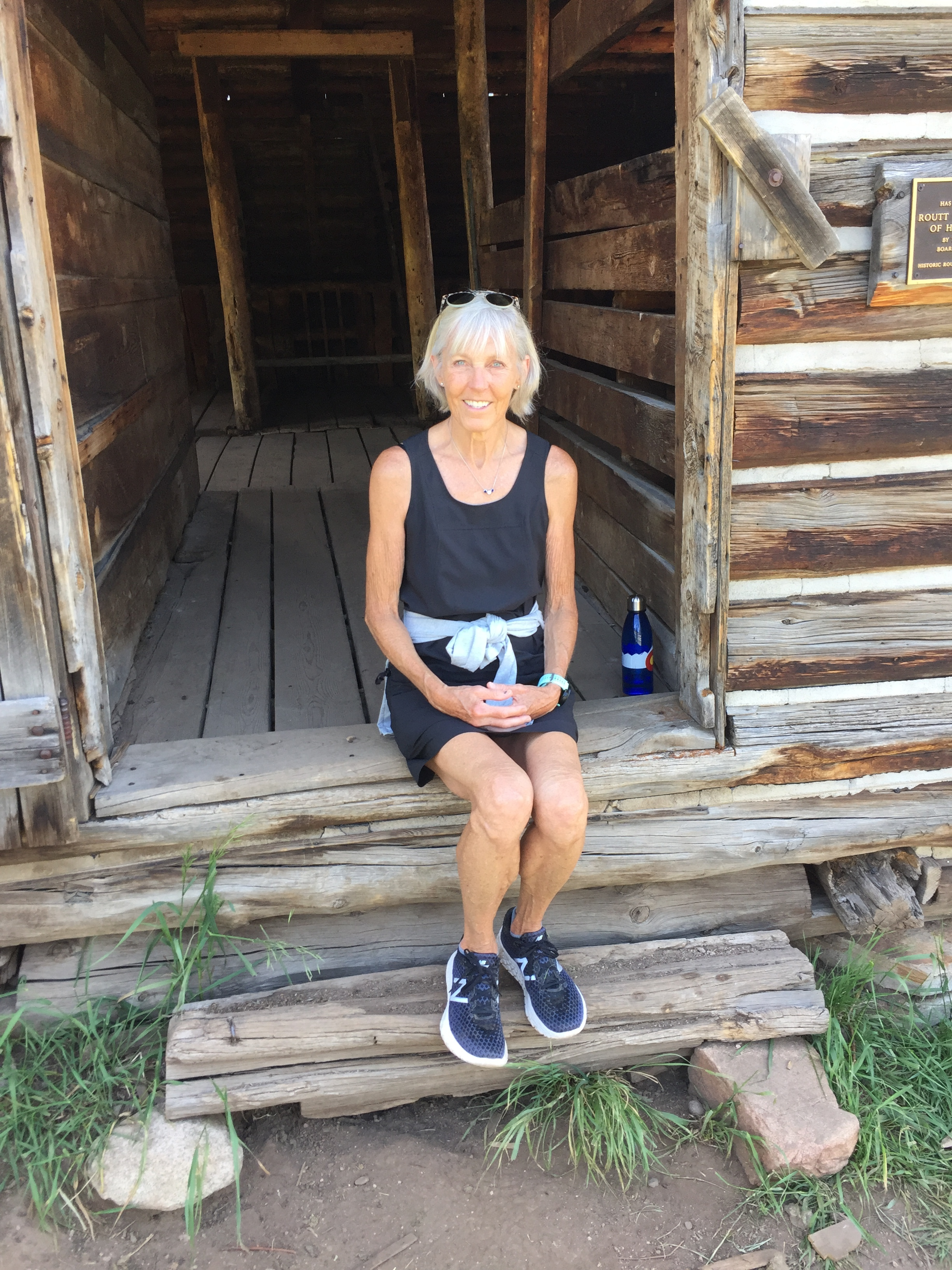 Here I am on steps of Mad Barn, built in 1905 and remodeled in early 2000s, about mid-way through hike.