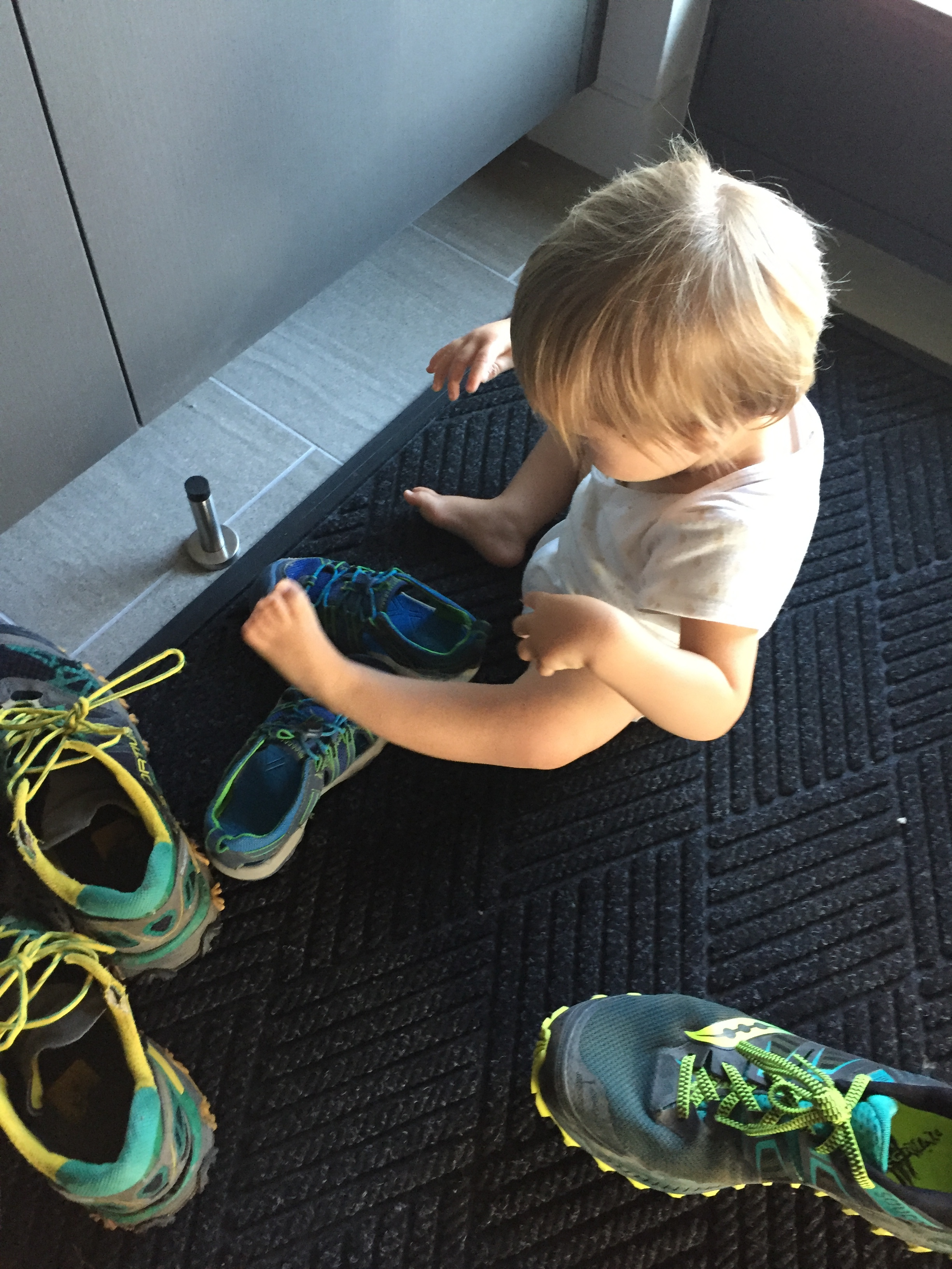 Trying on brother's shoes.