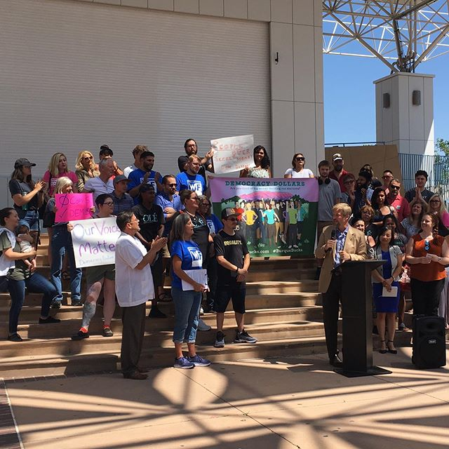 "On the ballot in November! Albuquerque Democracy Dollars (""Burque Bucks"") will give ALL Burqueños a stronger voice in our city government. @mayorkeller and many others show their support at today's press event and community rally. 🙌"