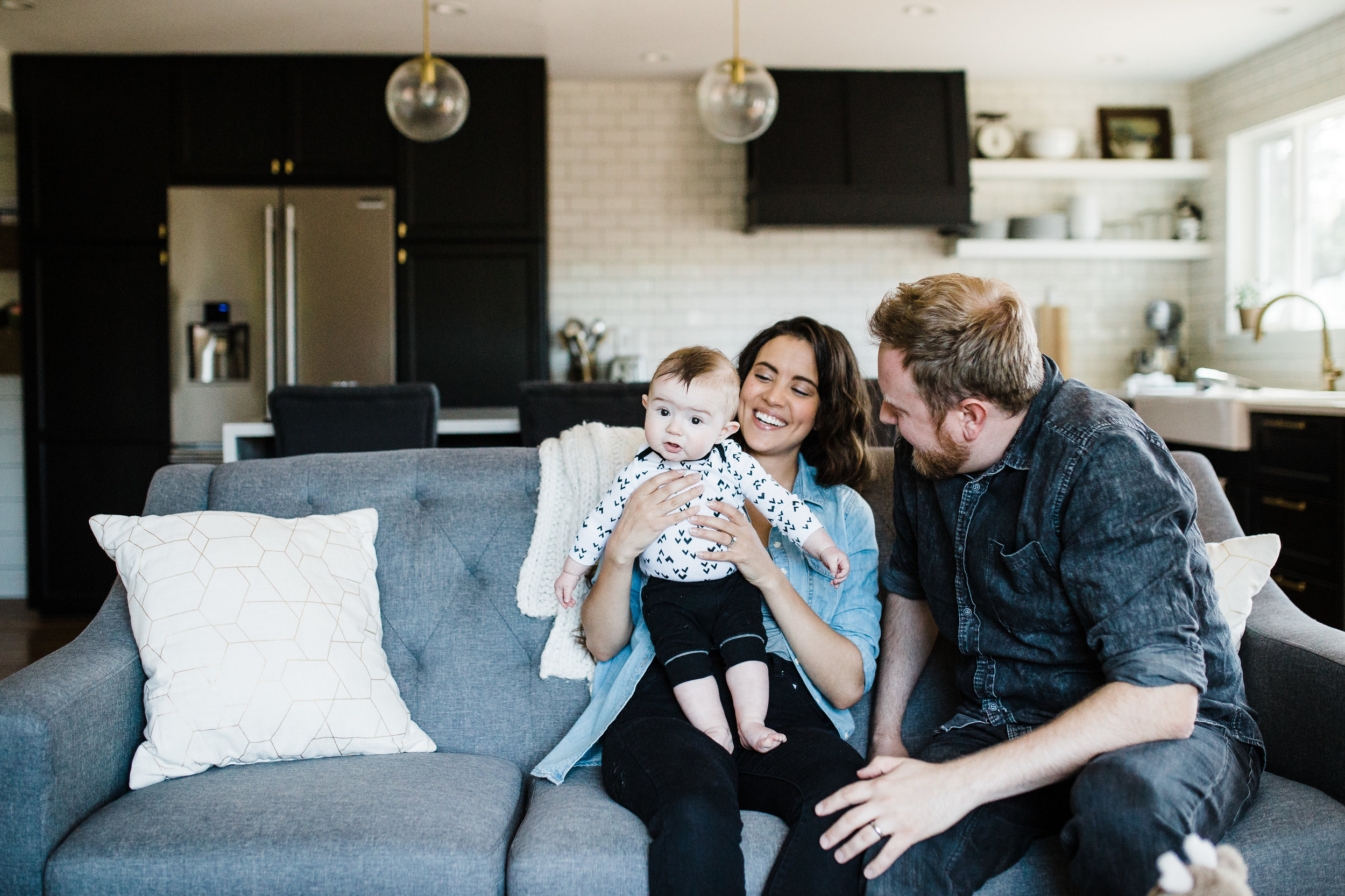 Parents and baby in home lifestyle photo session by Lily Jean Photography
