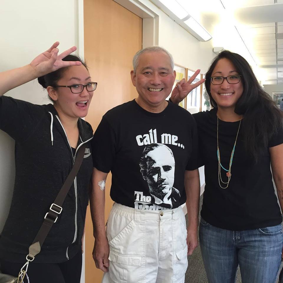 Accompanied by his two daughters,Alysa (left) and Mari (right), Alleaves his latest doctor's appointment with good news that his cancer is shrinking.