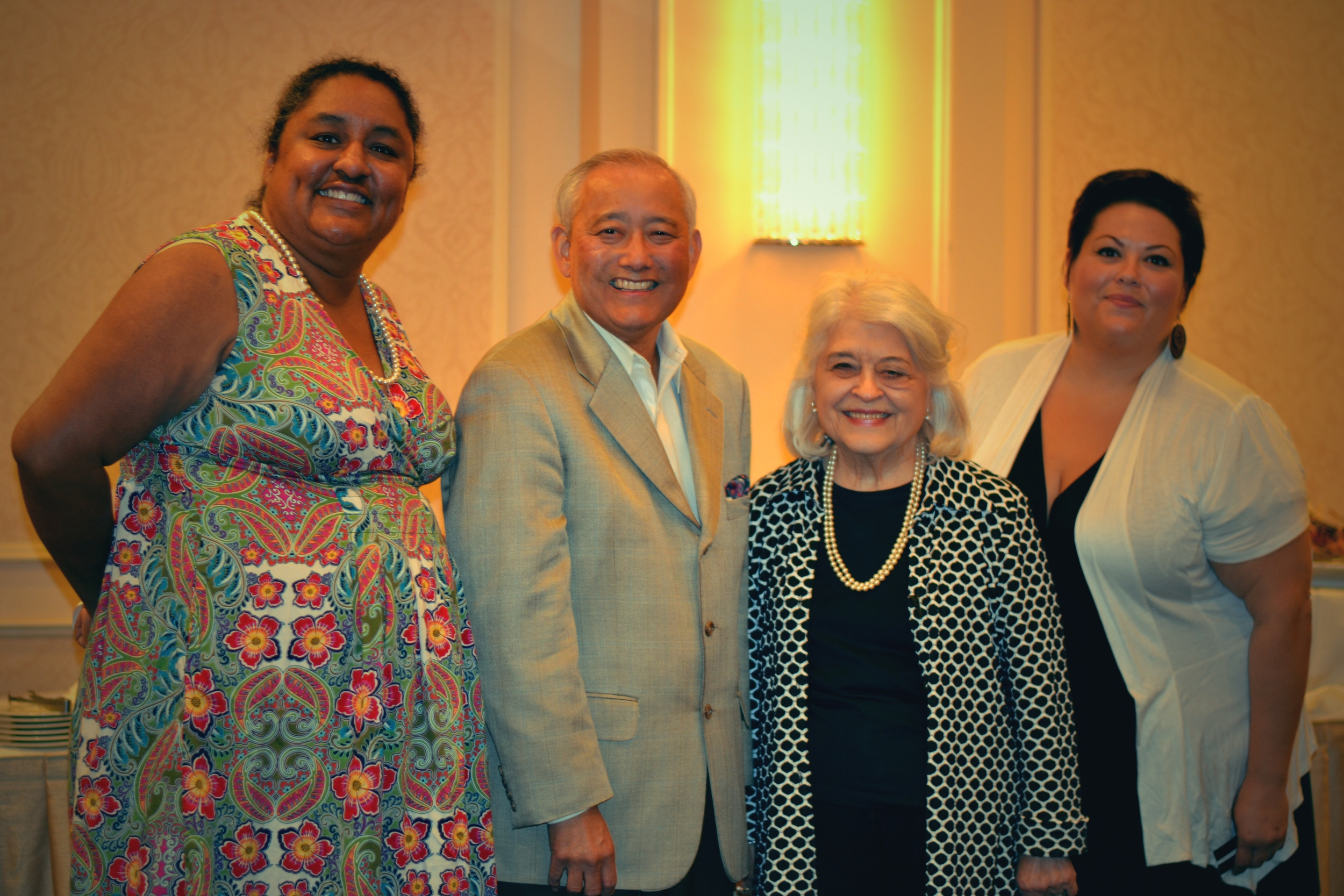 Above : EDI's Executive Director Emeritus, Alan Sugiyama, thanks Phyllis Kenney, former State Representative, and Sandra Huber & Sophia Beltran from Familias Unidas for coming to the event.