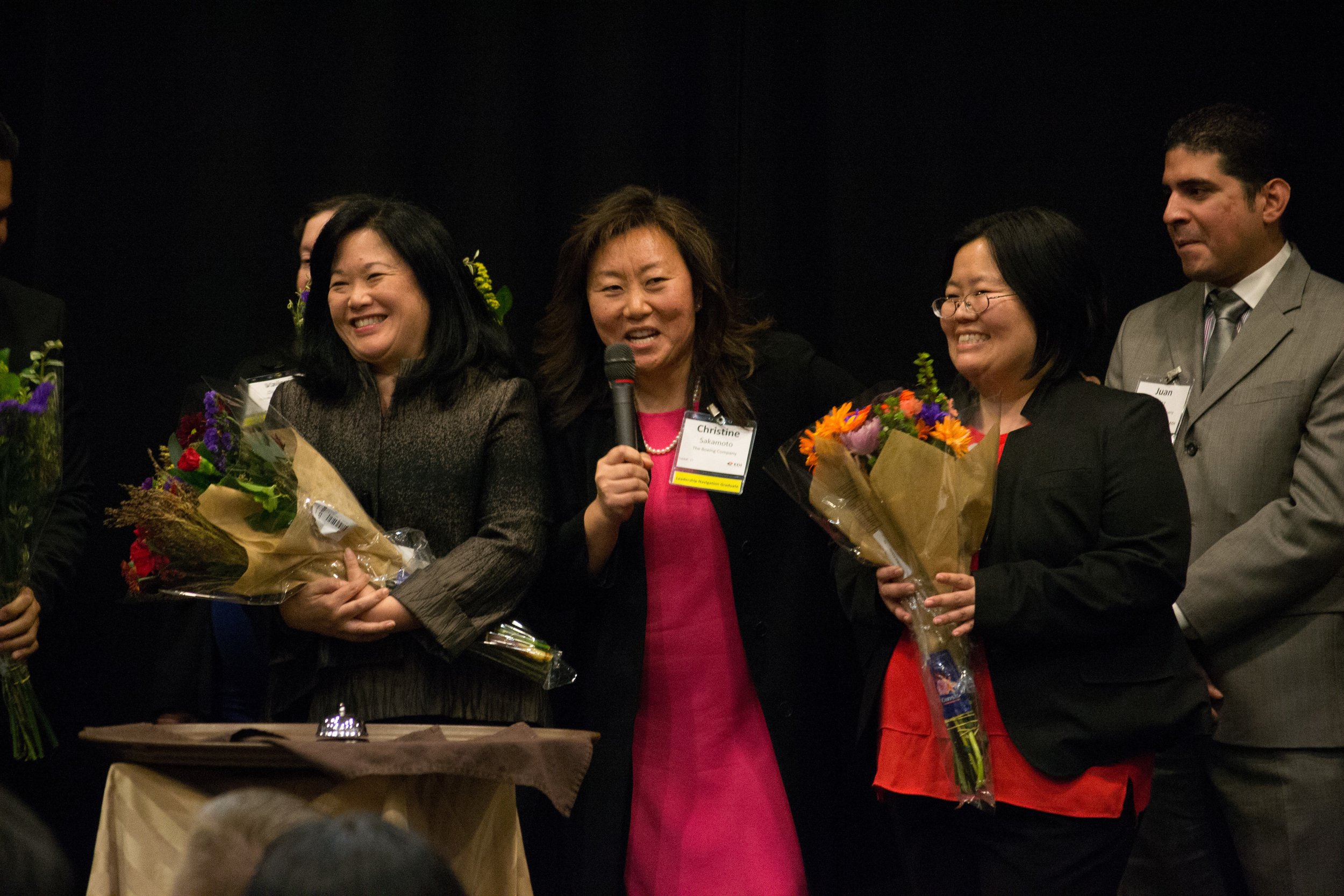Above : 2015 Navigation graduate,  Christine Sakamoto  (middle) presents flowers on behalf of her class to Navigation Program Director,  Colleen Yamaguchi  (left) and EDI's Executive Director,  Marci Nakano  (right).
