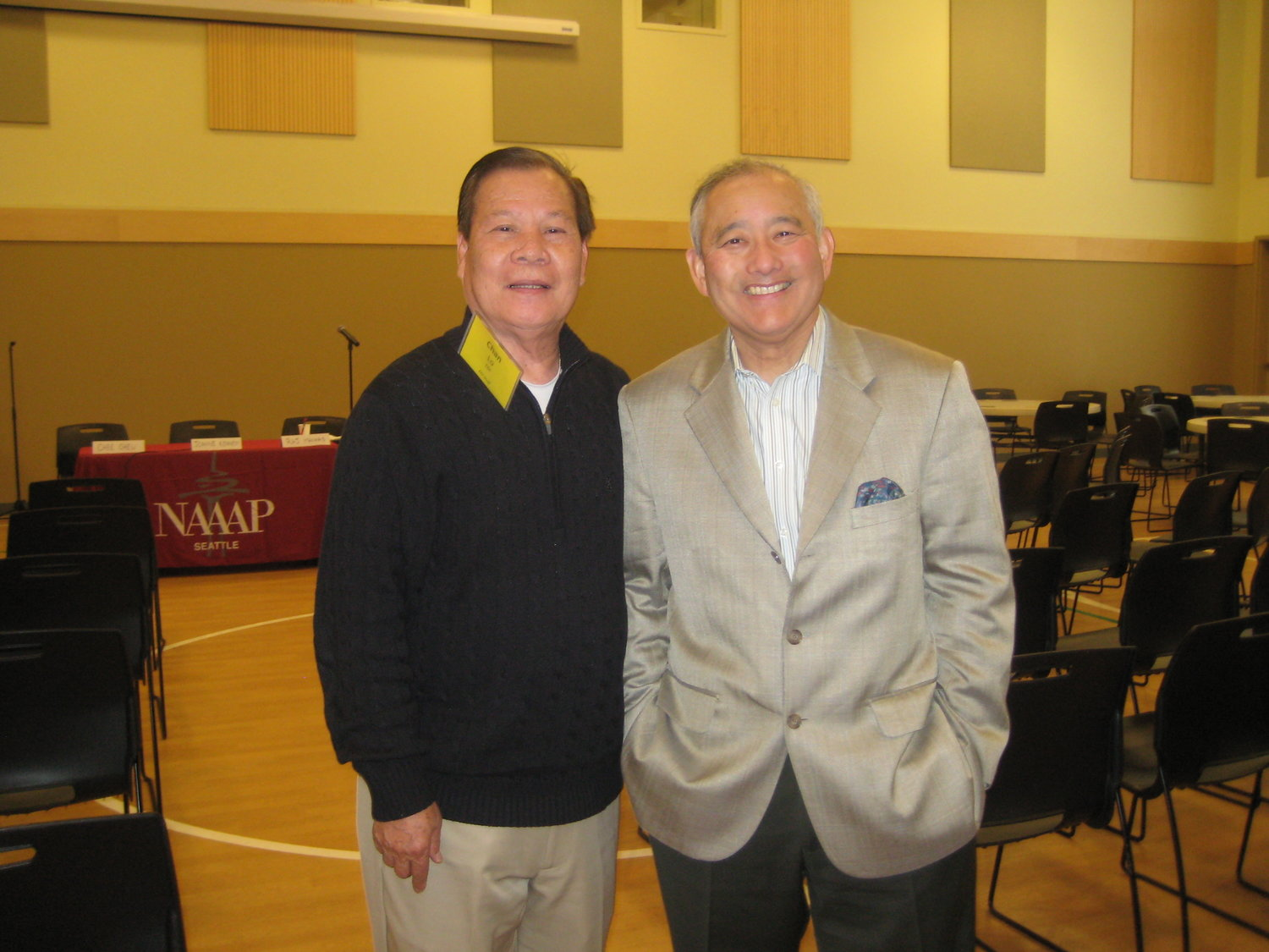Above:  In 2013,   EDI hosted a Leadership Together Conference at ACRS, inviting other organizations like NAAAP-Seattle. The 'brothers' Chan and Al pose for a photo at the event.
