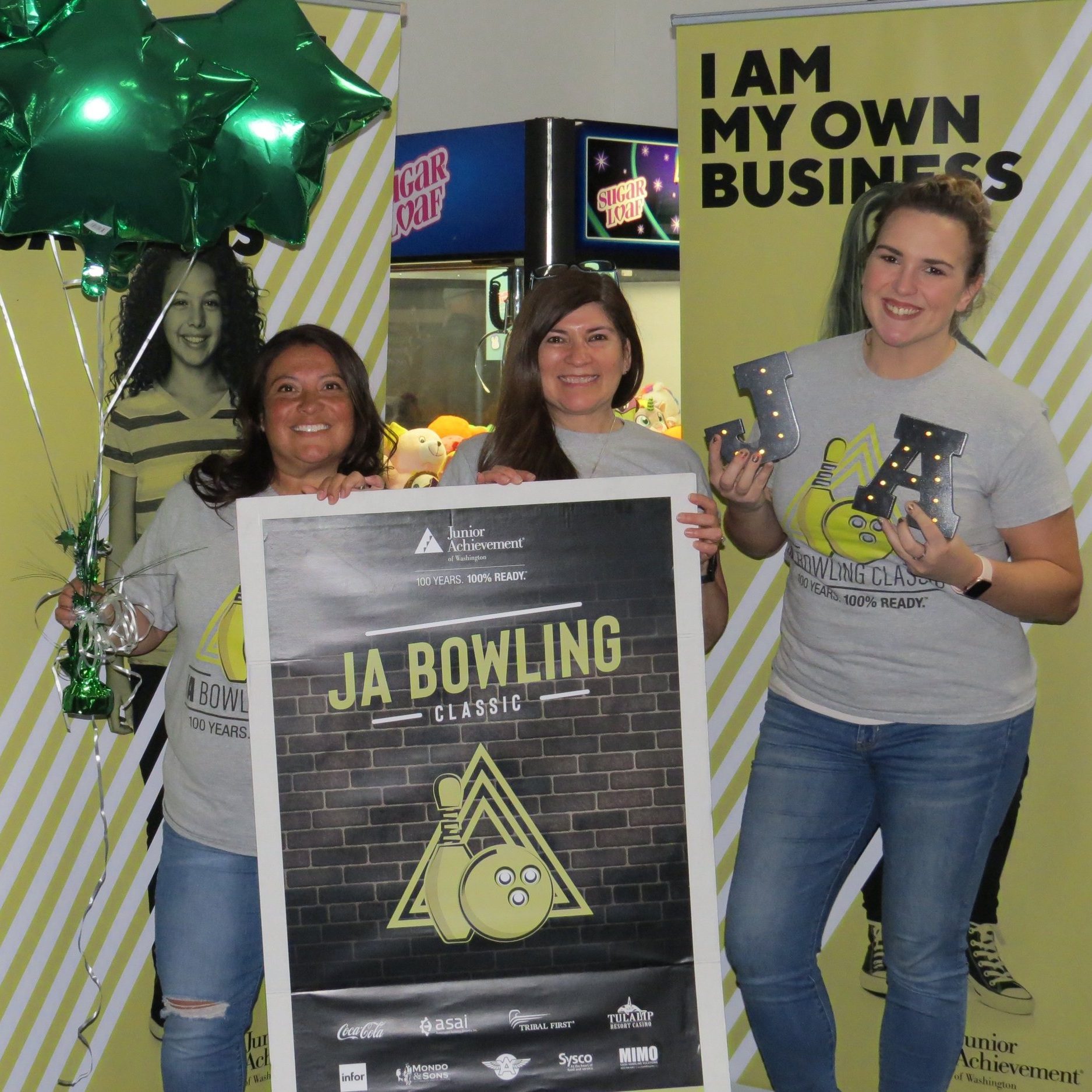 Carmen (center) at the JA Bowling Classic fundraising event