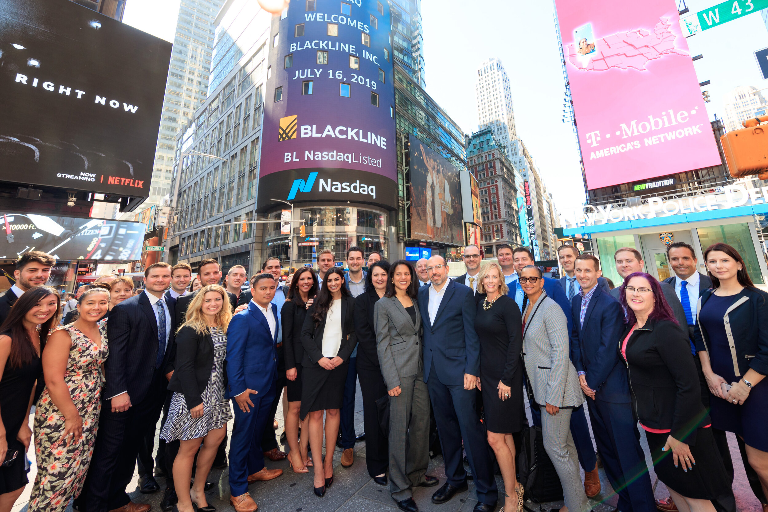 Joe (blue suit left of center) with his BlackLine team in NYC.