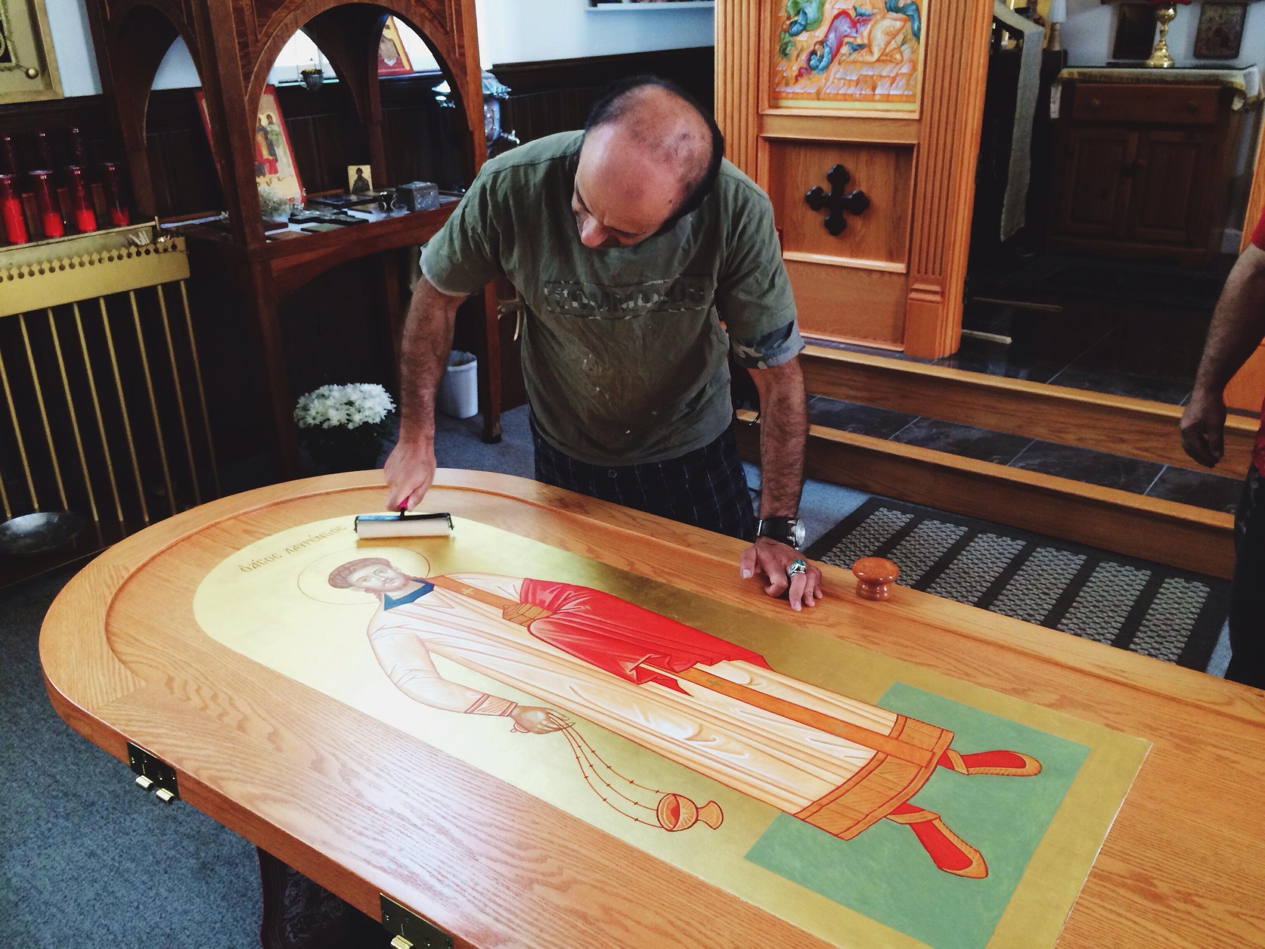 Valentin Streltsov installs the icon of St. Lavrentios
