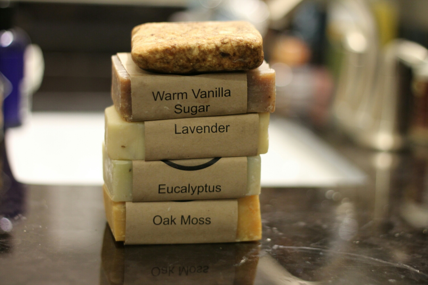 Top to bottom: Black African, Warm Vanilla Sugar, Lavender, Eucalyptus, & Oak Moss soaps from Abundantly Aromatic